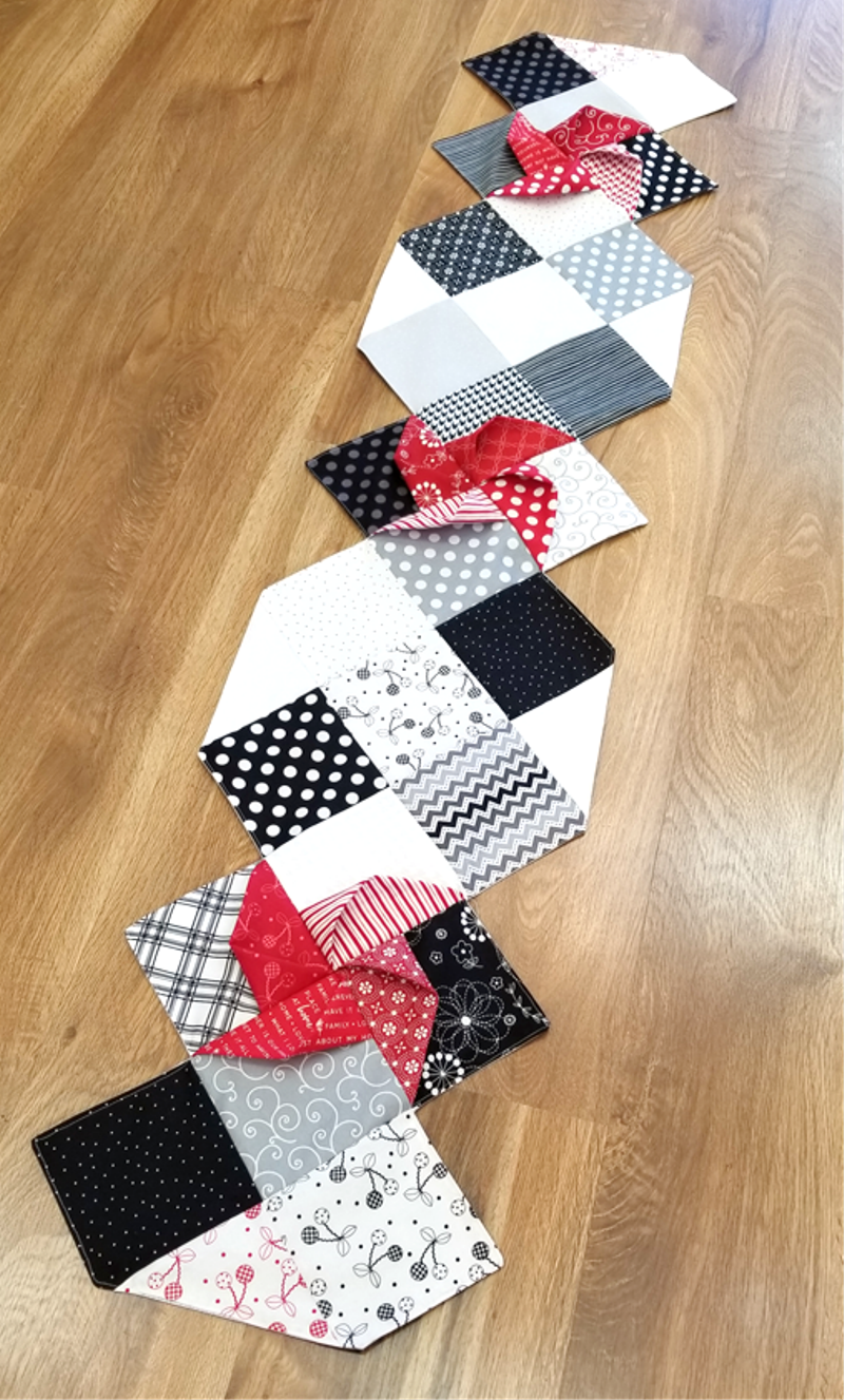 Red, Black and White Pinwheel Table Runner