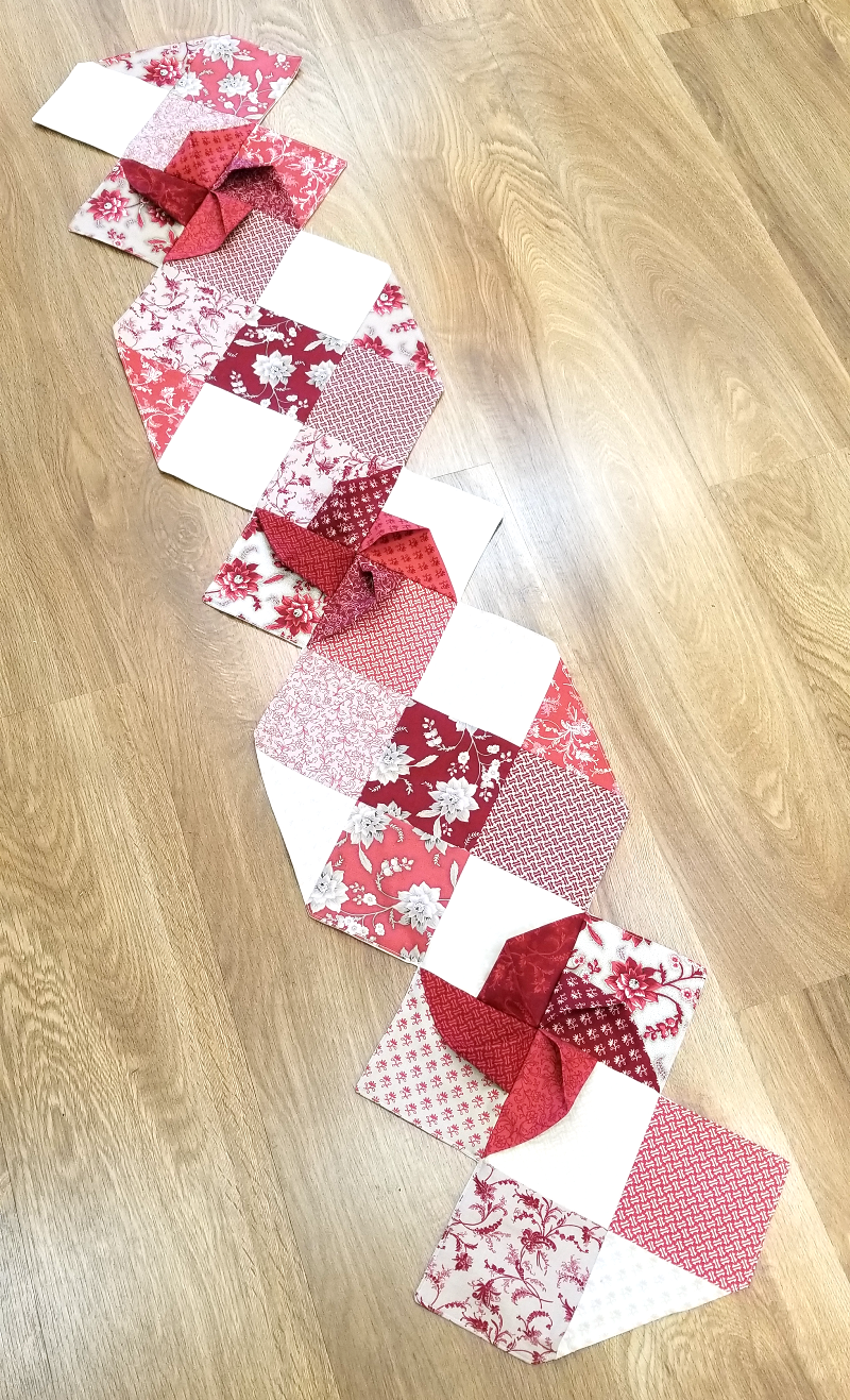 Shades of Red Pinwheel Table Runner