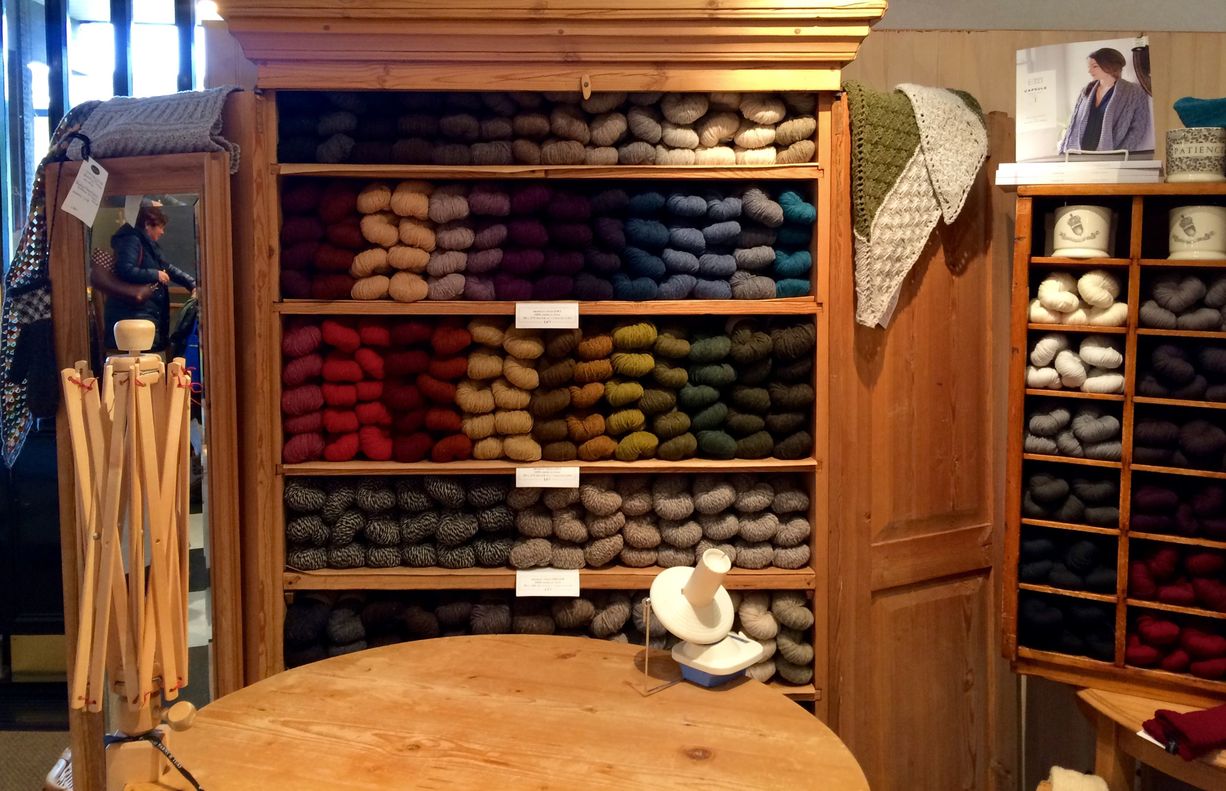 A wardrobe full of yarn just waiting to be wound. The sweet staff will happily wind your yarn for you on site.
