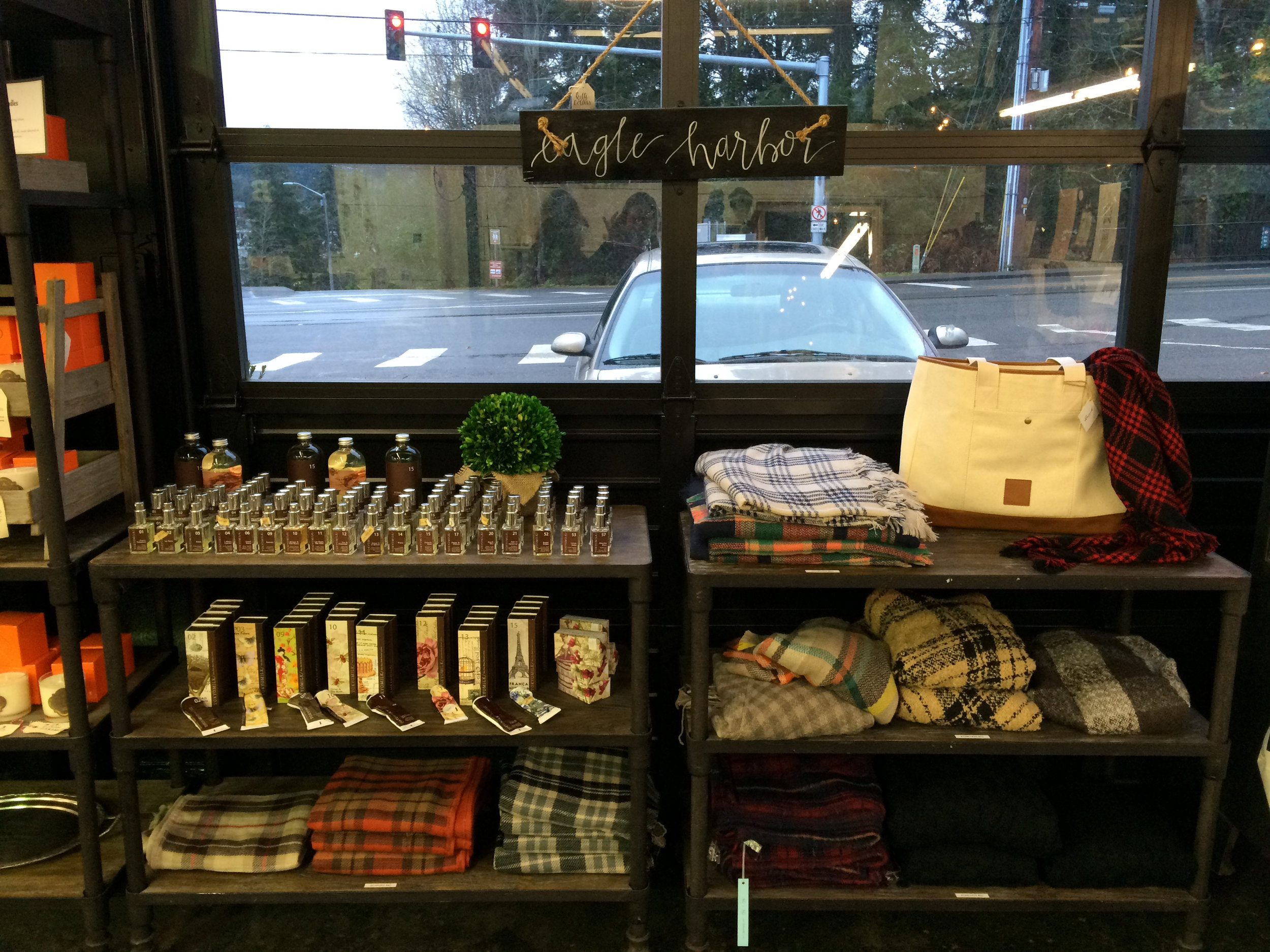 You need one of these travel blankets - trust me. And the signs can be customized to read anything and are, of course, made on Bainbridge Island!