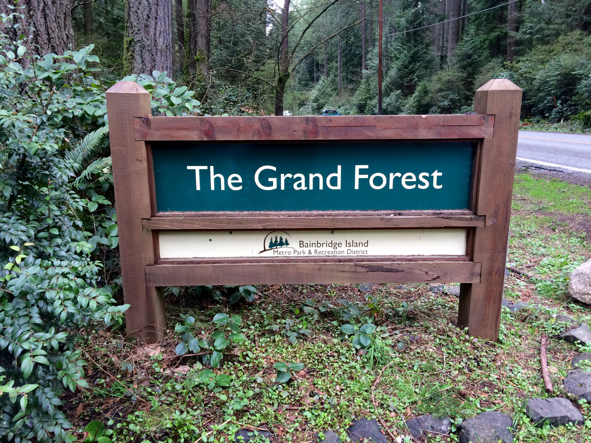 The Grand Forest road marker for the parking lot