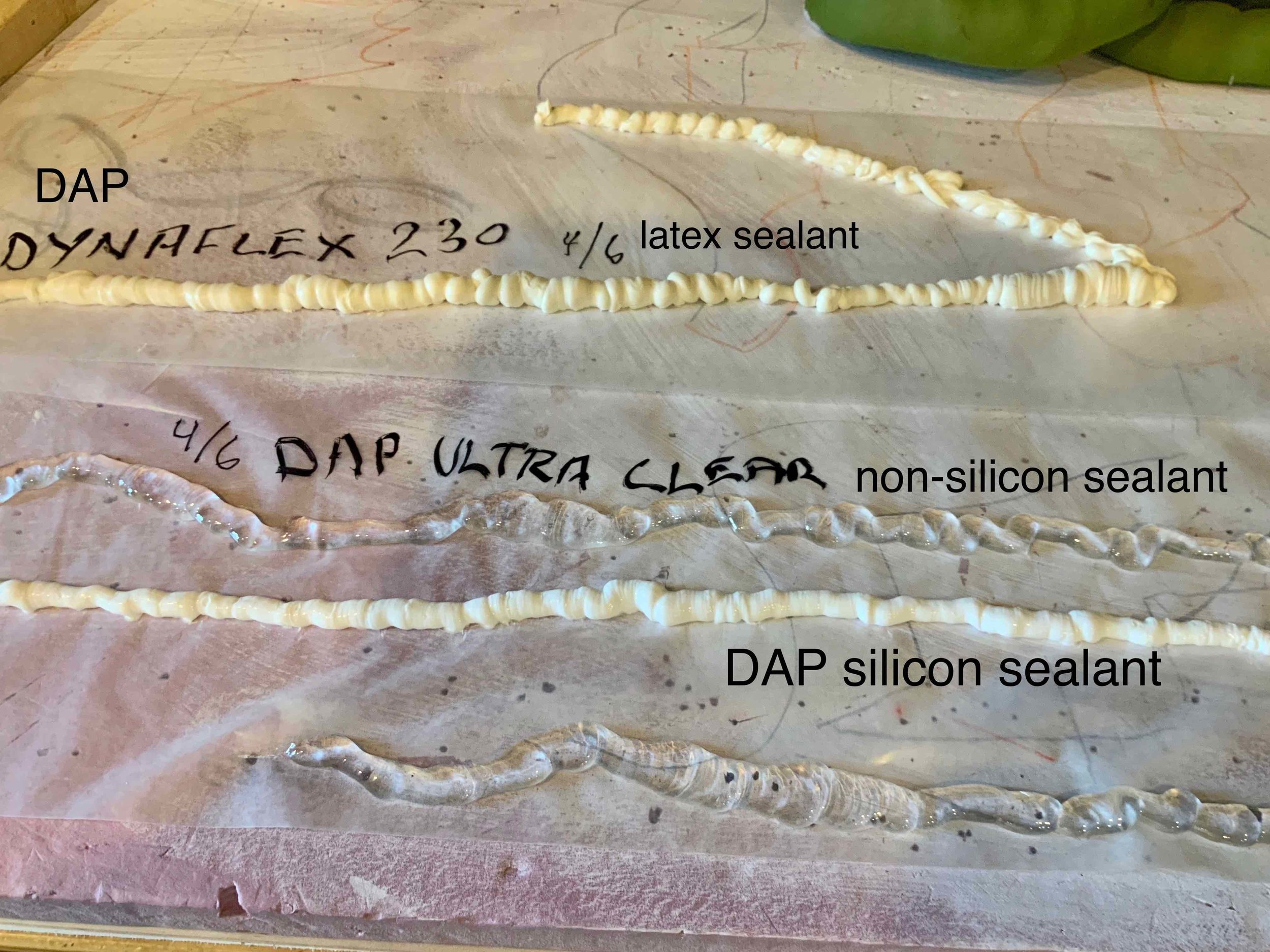 Next, we tried bathroom sealants as cores. Below the white DAP silicon sealant is another length of the DAP Ultra Clear.  The Ultra Clear worked best for a couple of reasons. We could more easily squeeze out a wonky, fat then thin bead. When cured, it felt the strongest of the 3.  The latex bead at its fattest never really felt fully cured and stayed squishy soft. It seemed weak.