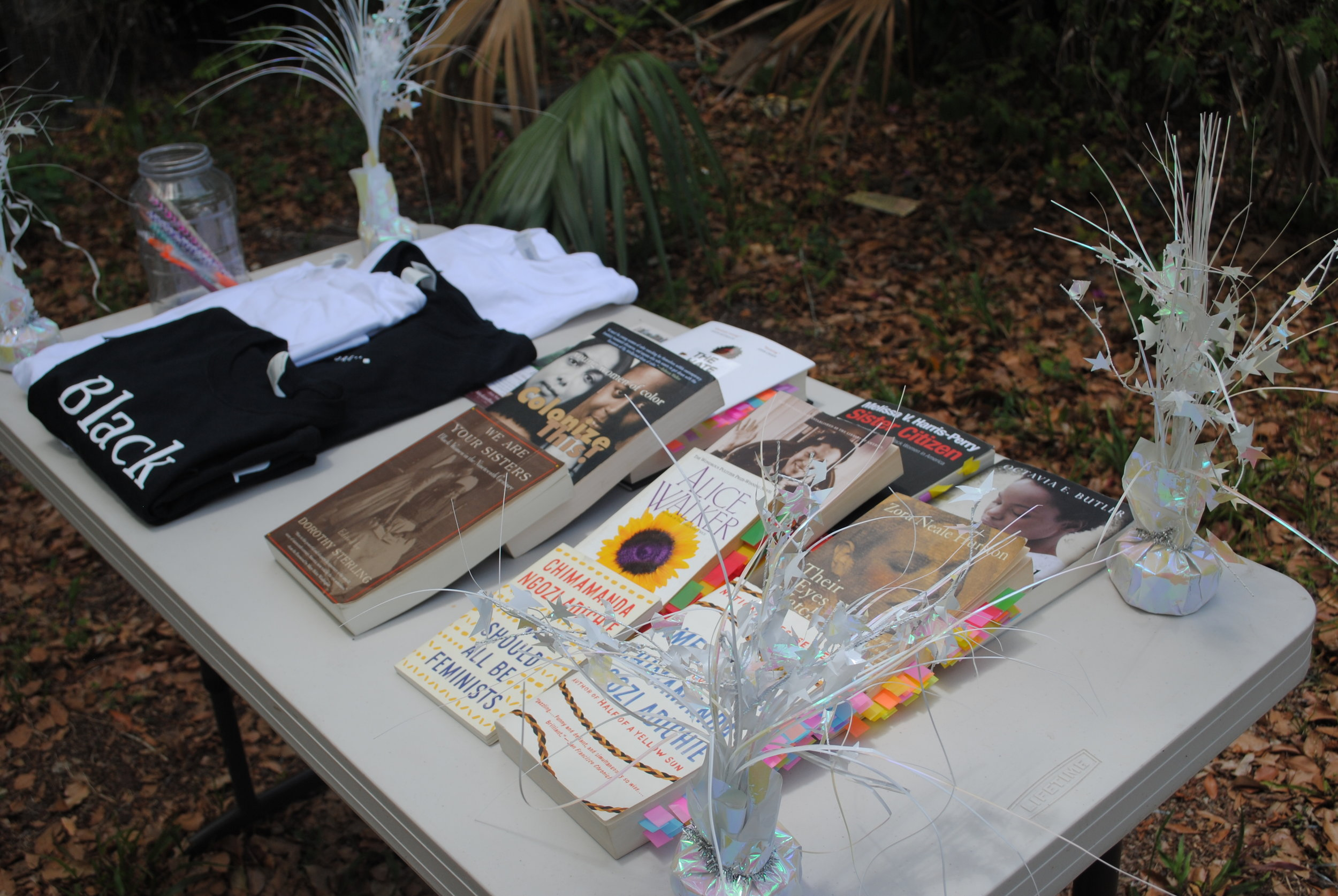 Table With Books and Tshirts