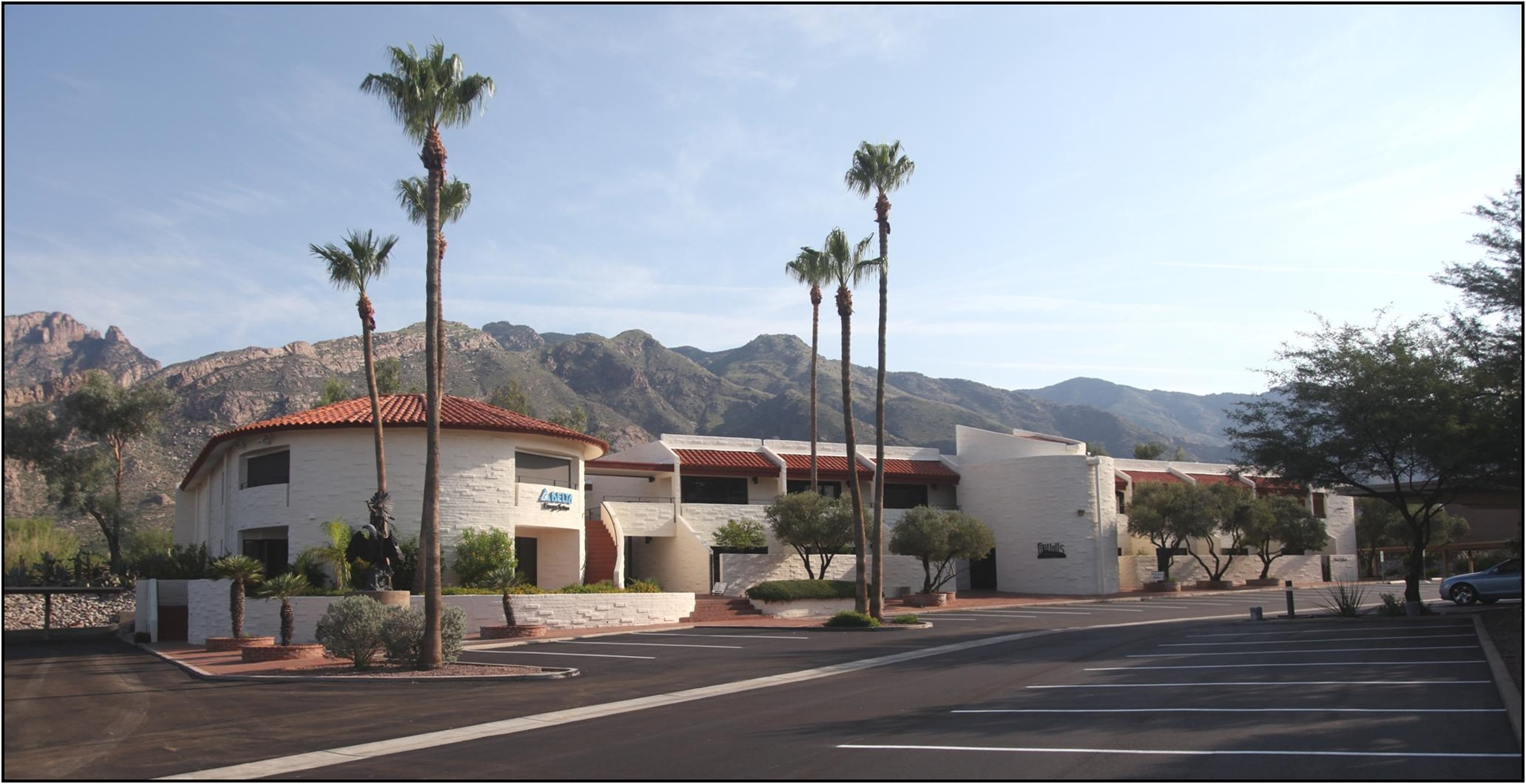 Tucson psychiatry office exterior building, palm trees, and parking lot