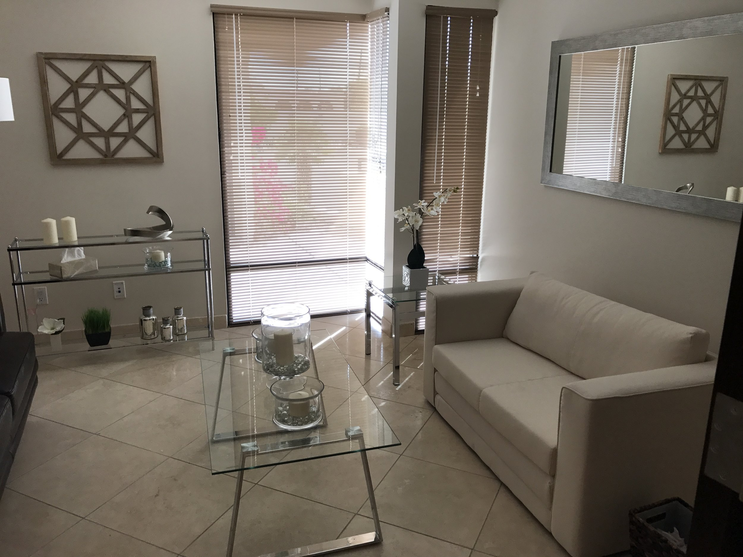 Seating area with couches and glass tables