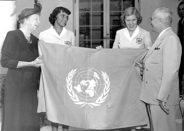 In this photo, Eleanor Roosevelt and President Harry Truman hold the UN flag at the White House. The White House photographer took this photo on September 7, 1950.