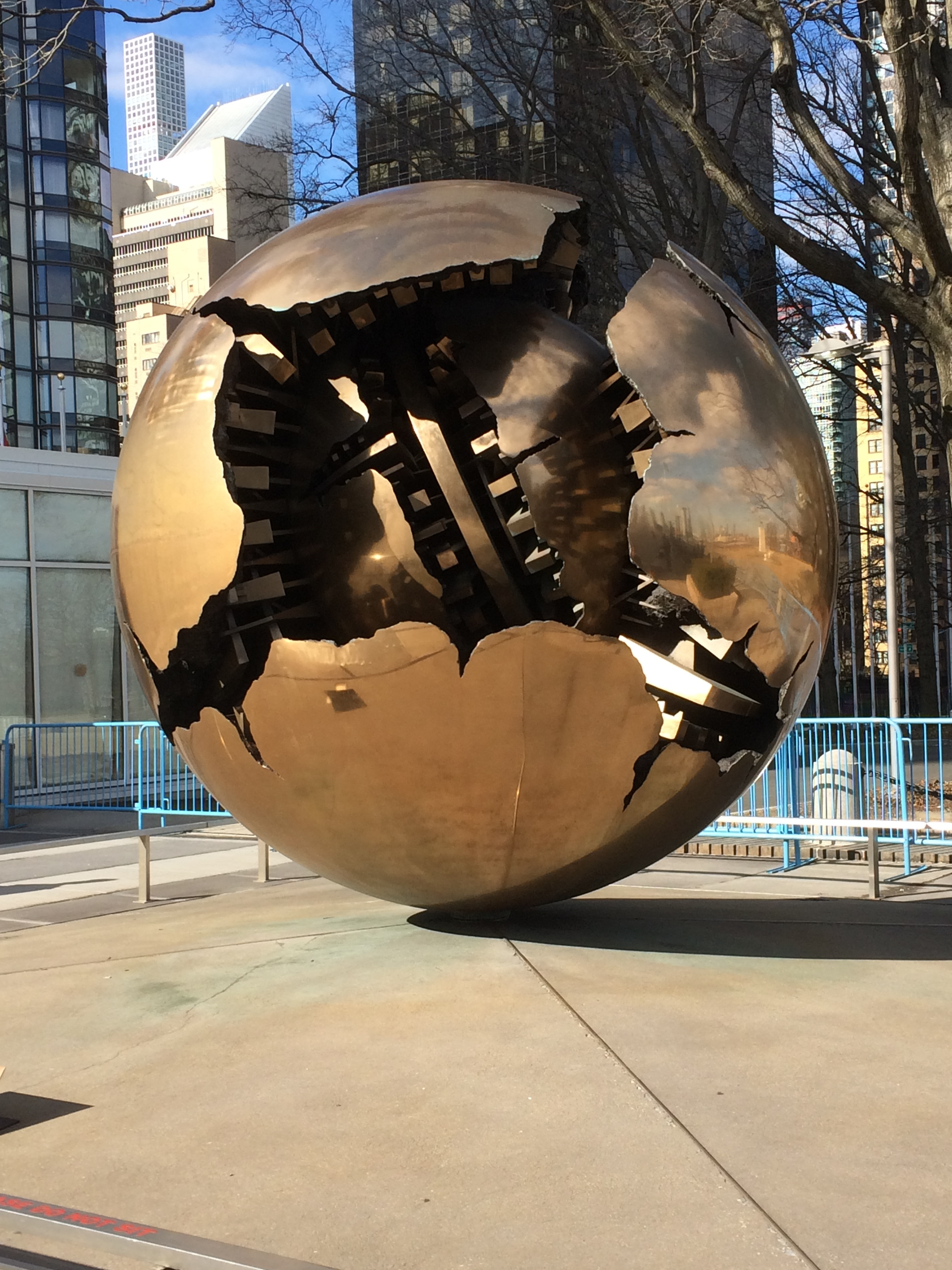 """""""A sphere within a sphere"""" by Arnaldo Pomodoro, is situated in the Visitor's Plaza at UN headquarters in New York City."""