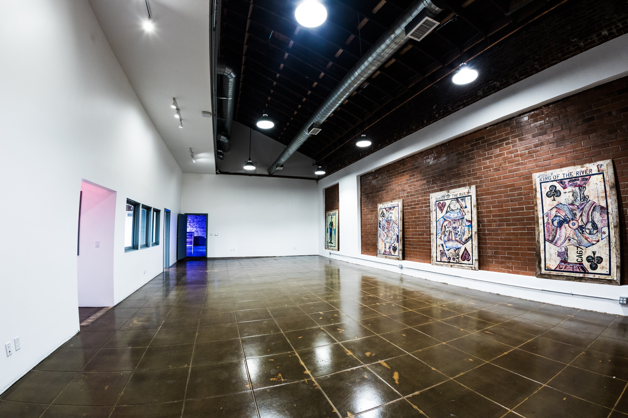 Gallery - High ceilings and plenty of wall space make this entry room an ideal art gallery. Adorned with vintage light fixtures, and brick & stucco walls, the Gallery is suitable as the gateway to a larger event, or a standalone affair.