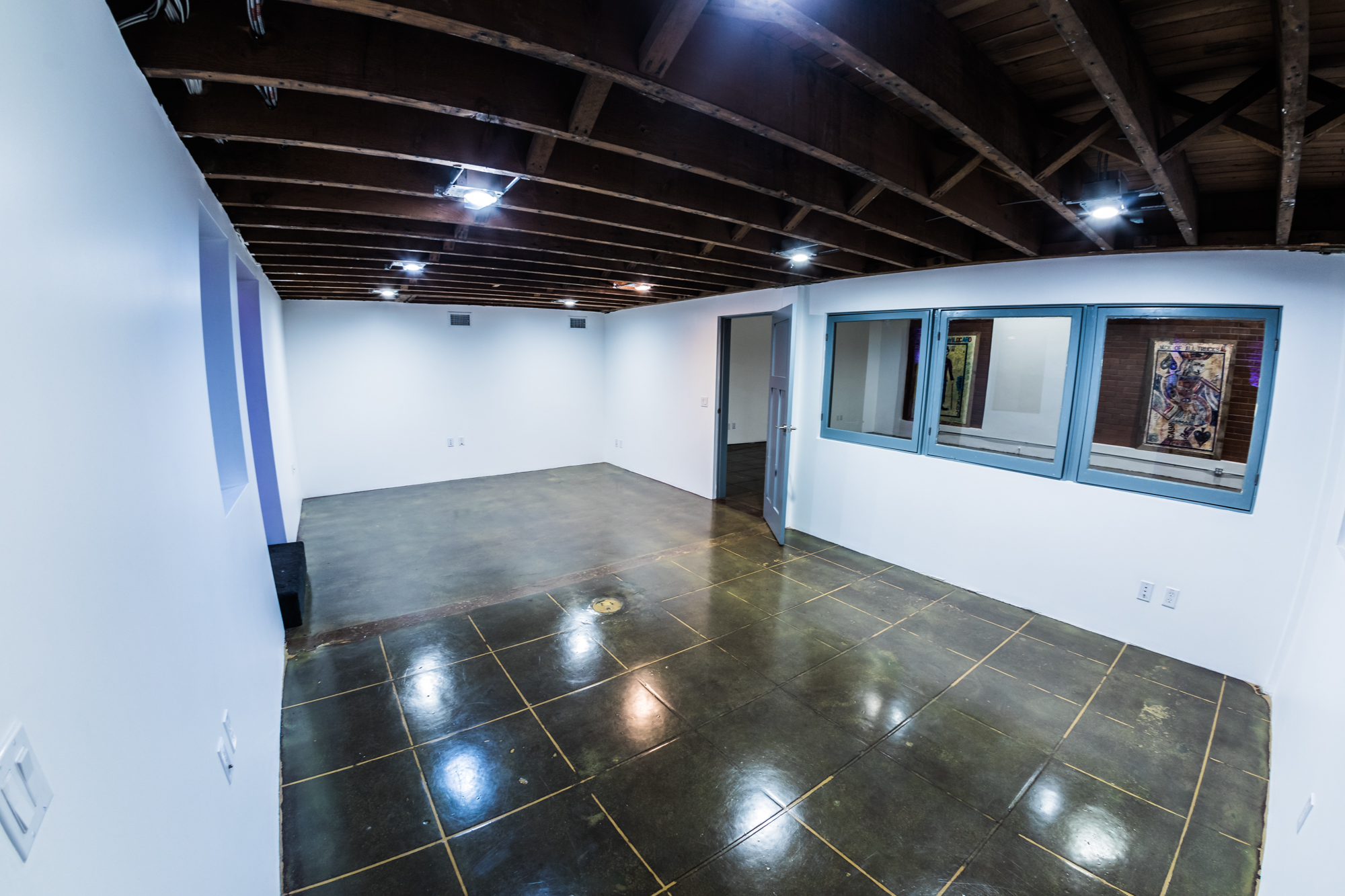 Annex - The Annex is windowed wit egress to both the Gallery and the Factory Studio, making for a fun adjunct theme space with multiple circuted power options, this area also bodes well for hair & make-up, a photo booth, or back of house production . services.