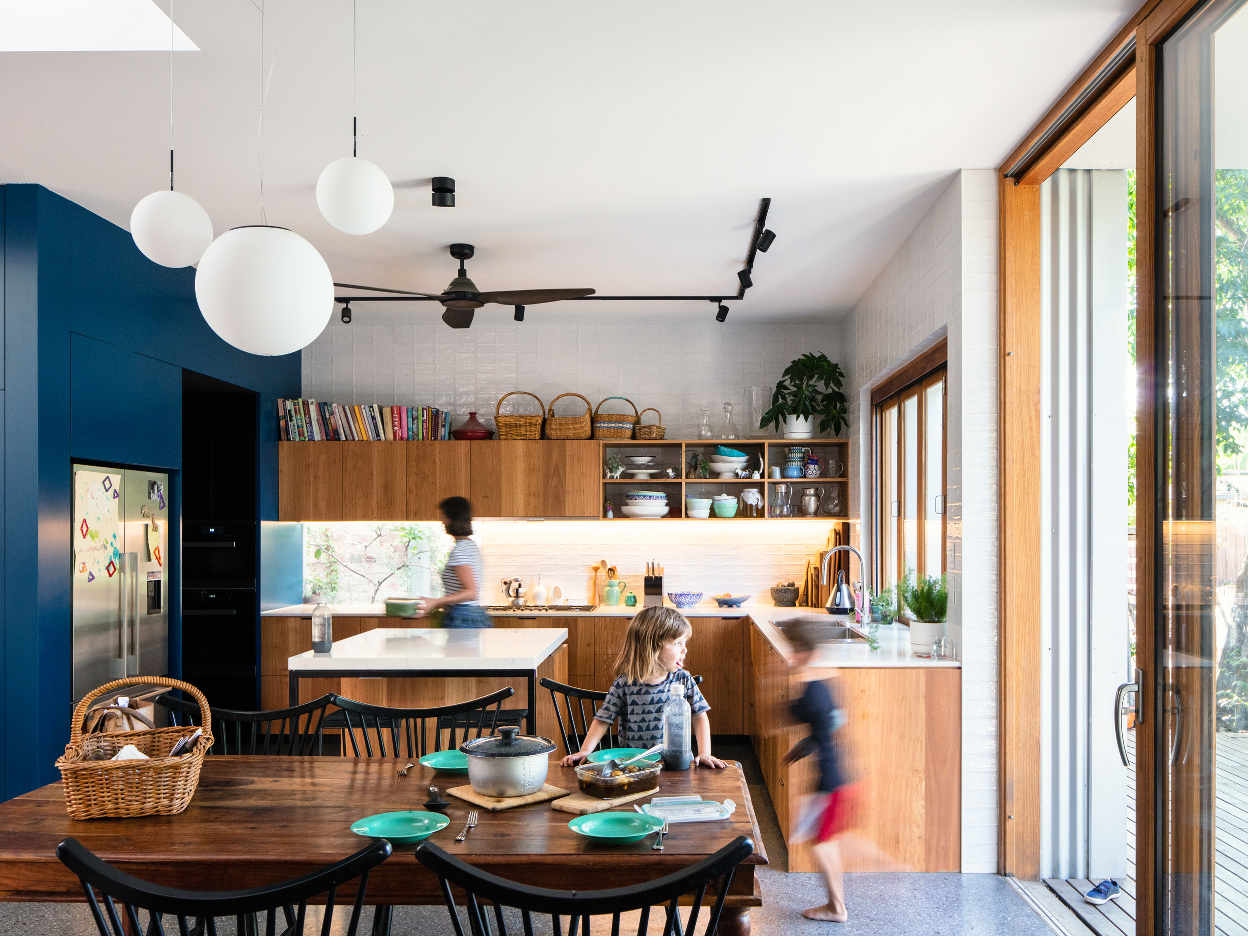 Large, open kitchen with great connection to outside. Image by Rory Gardiner.