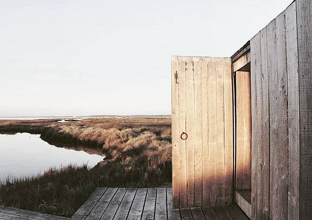 "PORTUGAL // These two fishermen's  huts on the Sado River near Lisbon have been beautifully reimagined into simple accommodation by @silent__living to create Cabanas No Rio. ""This still and silent place brings calmness to whoever visits."" . Photos by: Nelson Garrido e Bernard Touillon"