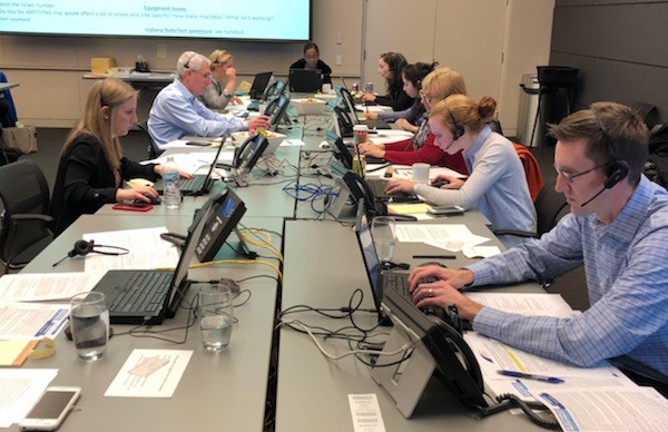 Volunteers answer calls from Illinois and Indiana voters at the Election Protection call center on November 6, 2018.