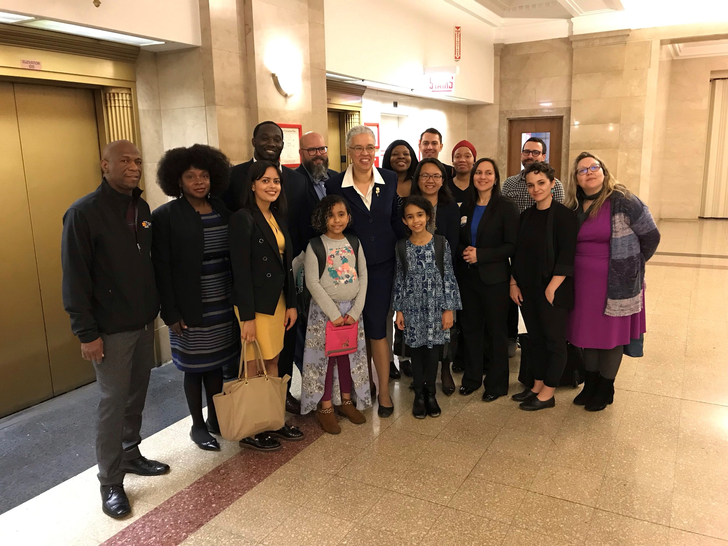 Advocates with the Just Housing Coalition join Cook County Commissioners at City Hall.