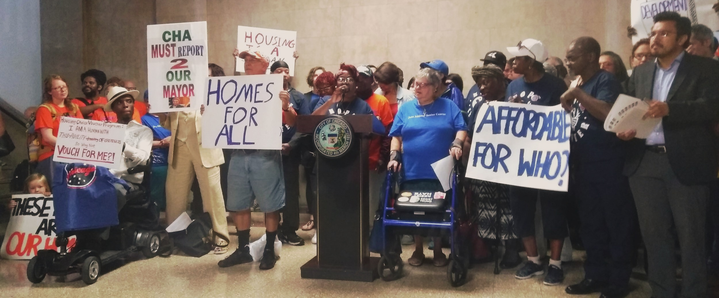 "Advocates with the ""Our Home, Chicago"" Coalition announcing the introduction of a comprehensive package of legislation including the Development for All ordinance this morning at City Hall."
