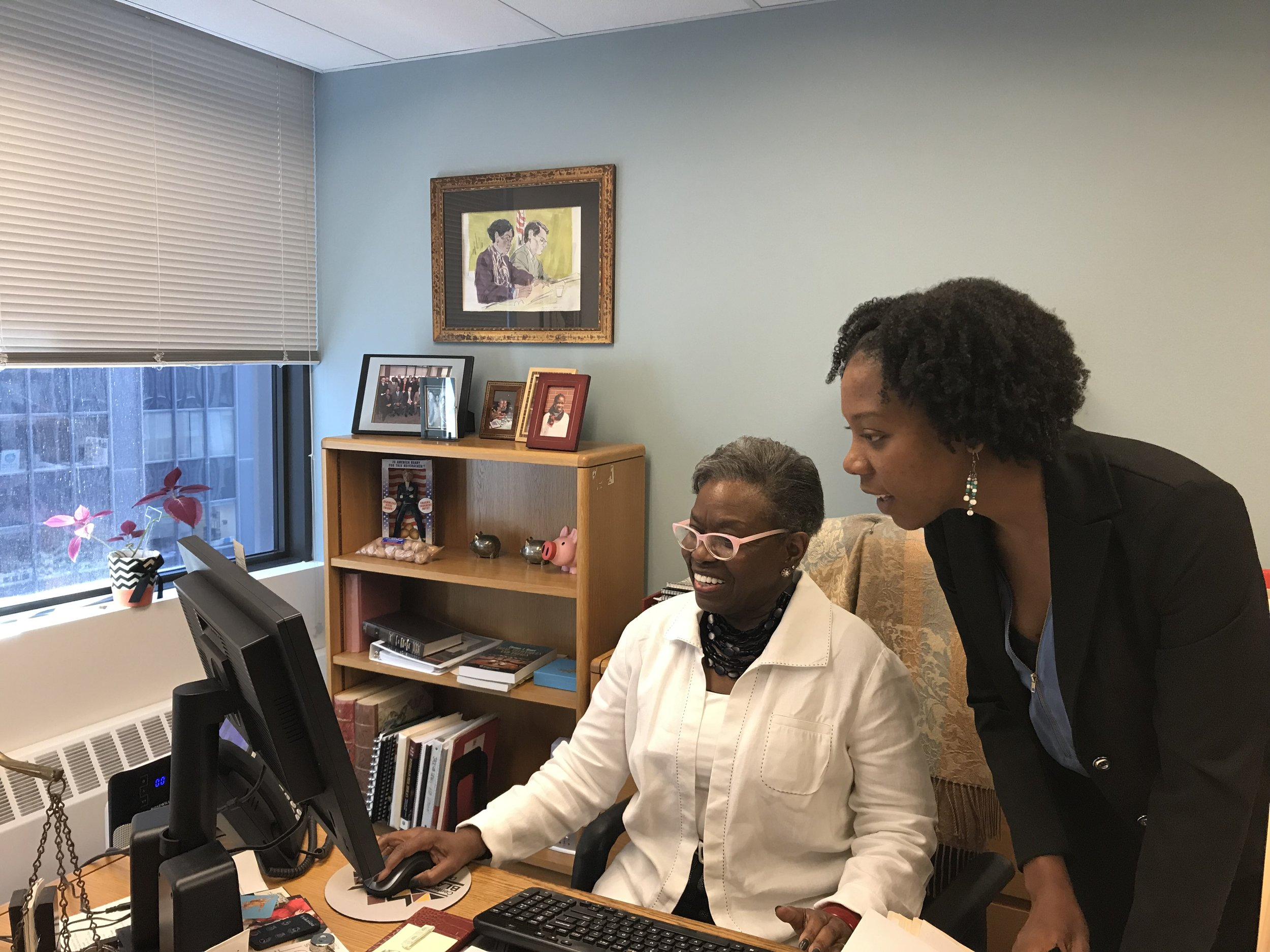 Natasha Wilkins (right) working with J. Cunyon Gordon, Director of the Settlement Assistance Program (seated).
