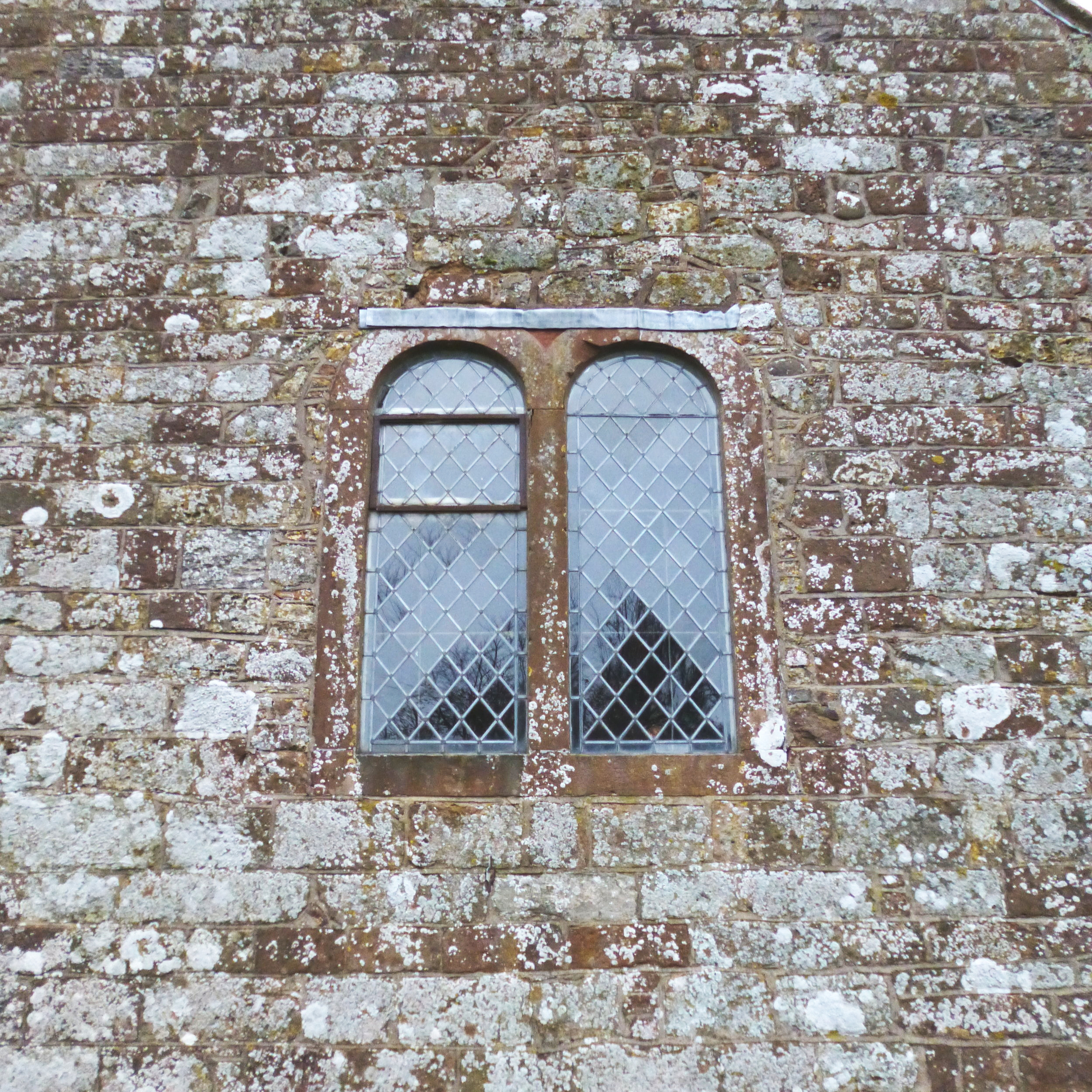 The west window was badly bowed and the iron casement was rusted and leaking