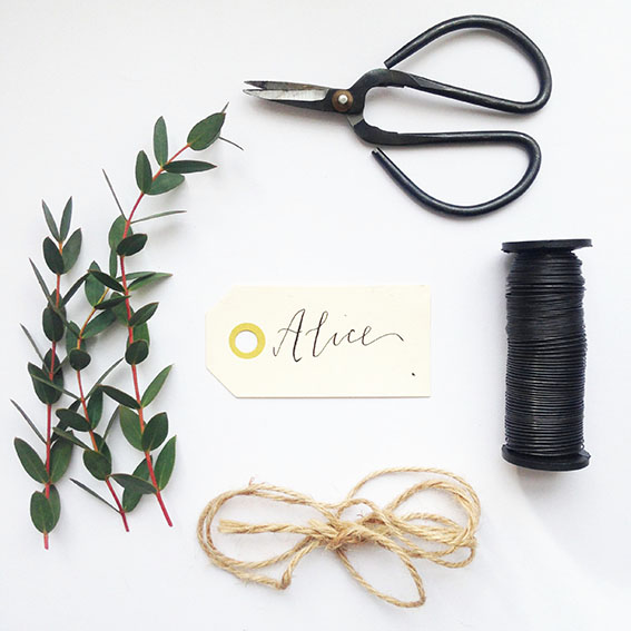 Materials: Eucalyptus, wire, sharp scissors, twine or ribbon, name tags (These hand lettered ones are available to buy from us with each name hand written, just pop over  here .   (quantities dependant on how many wreaths you are making)
