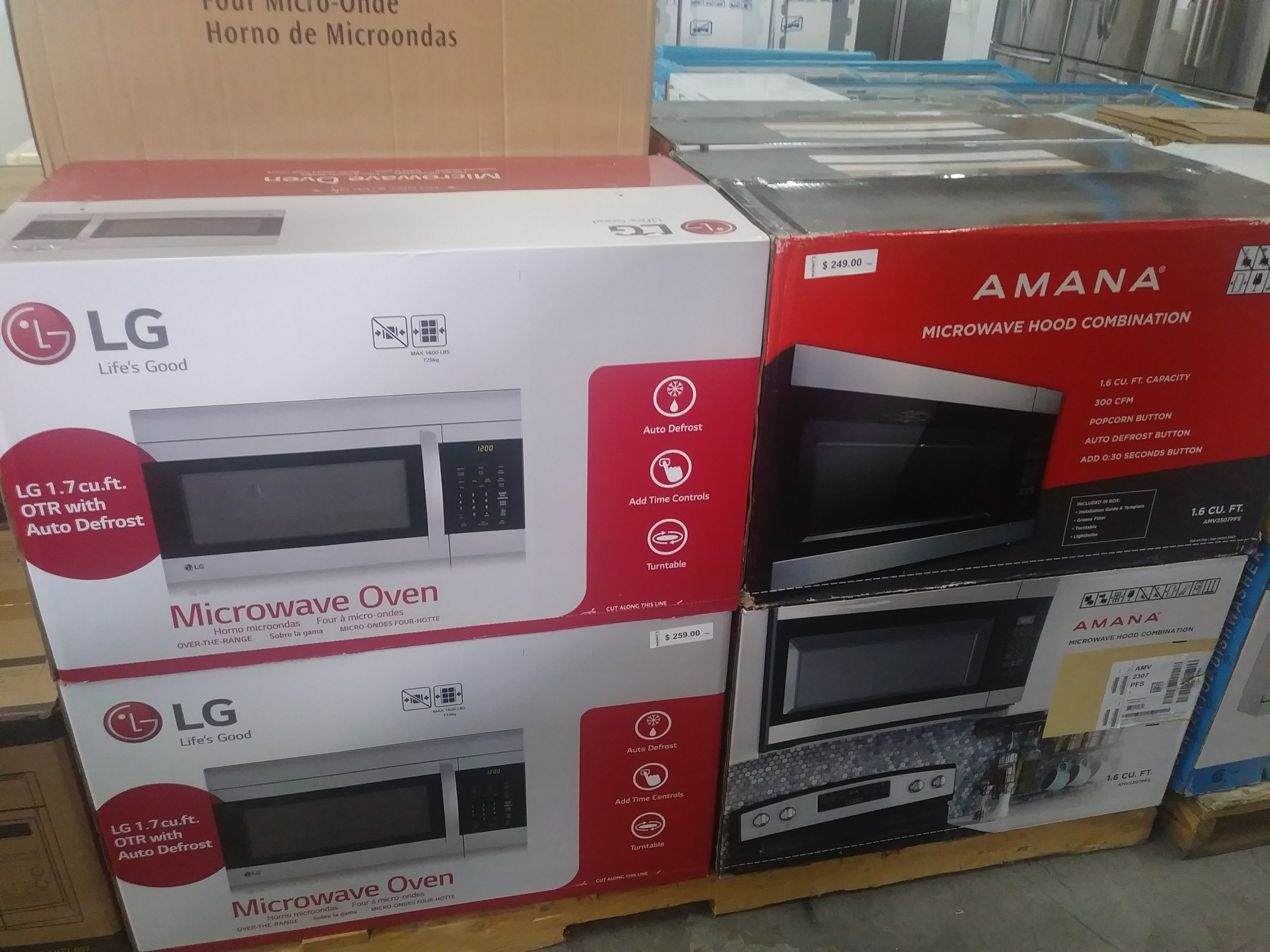 New Over the Range Microwave @ $250.00 ( 1 Year Warranty )