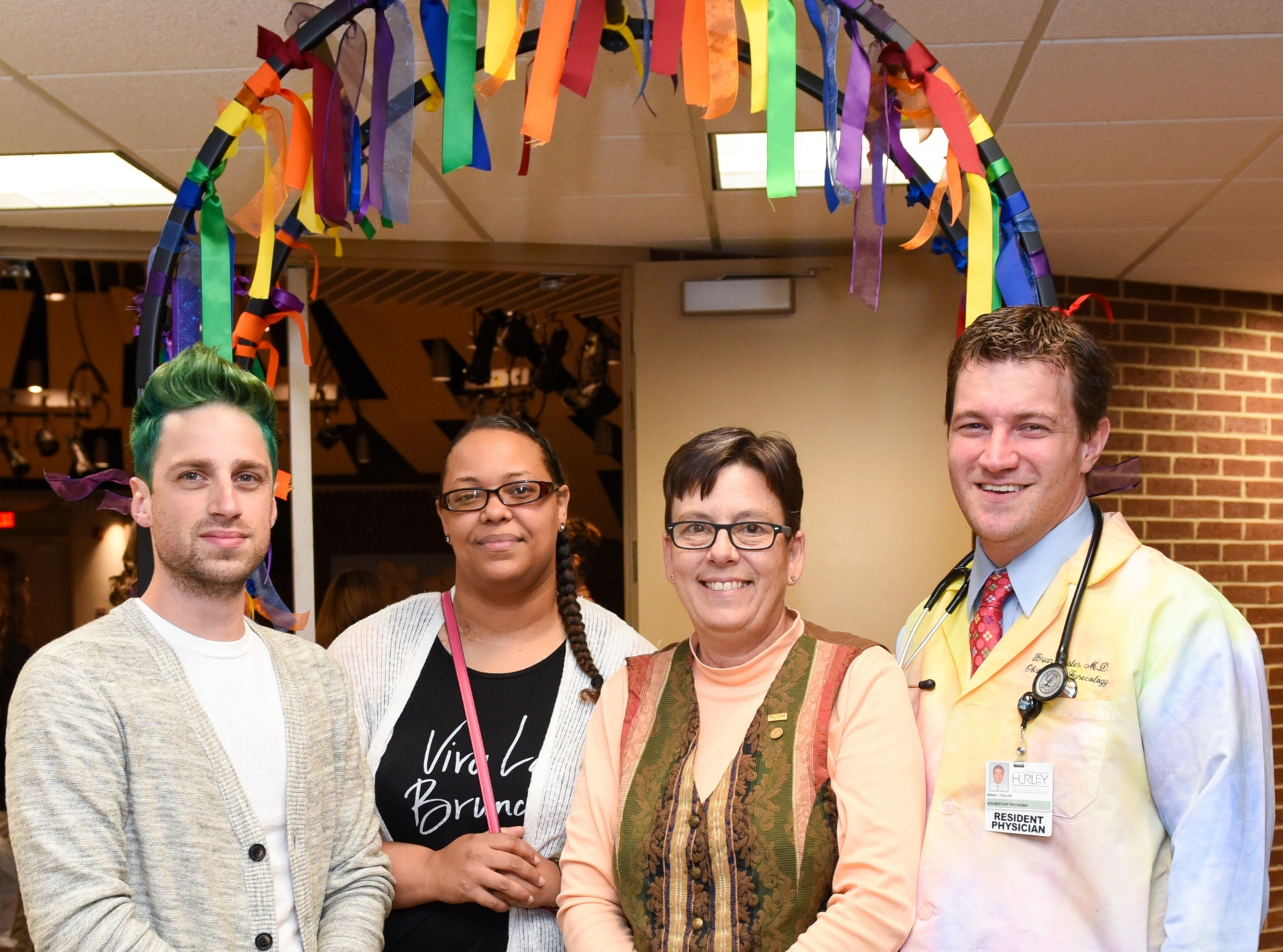 Dr. Tesler with  Wellness Services  Advocates at  Hurley Medical Center's  Pride Month