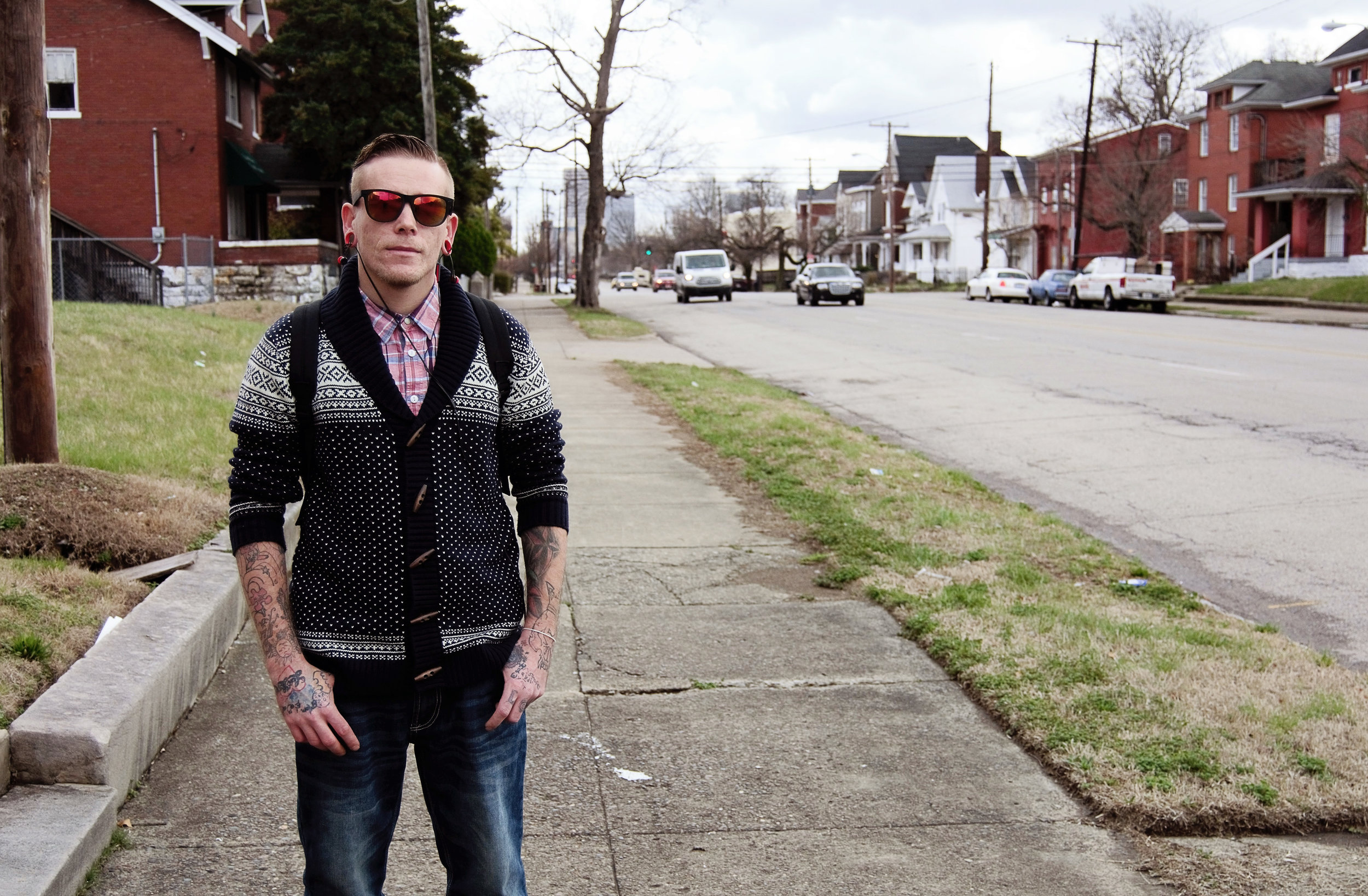 """""""In May of 2016, I went to the Healing Place and got sober. I've been sober since then. Recovery is strong, especially down here in the west end. In Louisville, period, there's like four hundred fifty something meetings a week. It's like the recovery capital of the country. It's a big deal, man. It's a lot going on, down here. Heroin is such an epidemic, you know what I mean, so why wouldn't it be? Homelessness drove me to recovery. My family told me that I couldn't come around because they didn't want me around their kids and around their stuff. I got tired of sleeping on the street, sleeping outside. I wanted to do something different and get my life back in order. I'm 28 years old. Being homeless for the past 3 years, I had a life before that. I had a house. I had a 5 bedroom house in Bullitt County. I had a wife, I had the kids, I had everything, man. I was doing it. I gave it all away for the dope. I gave it away, it wasn't taken away. AA and the Healing Place taught me how to see my part in this shit, man. Our Father's House is like an extension. It's teaching me a lot about myself."""" - Robert, Russell"""