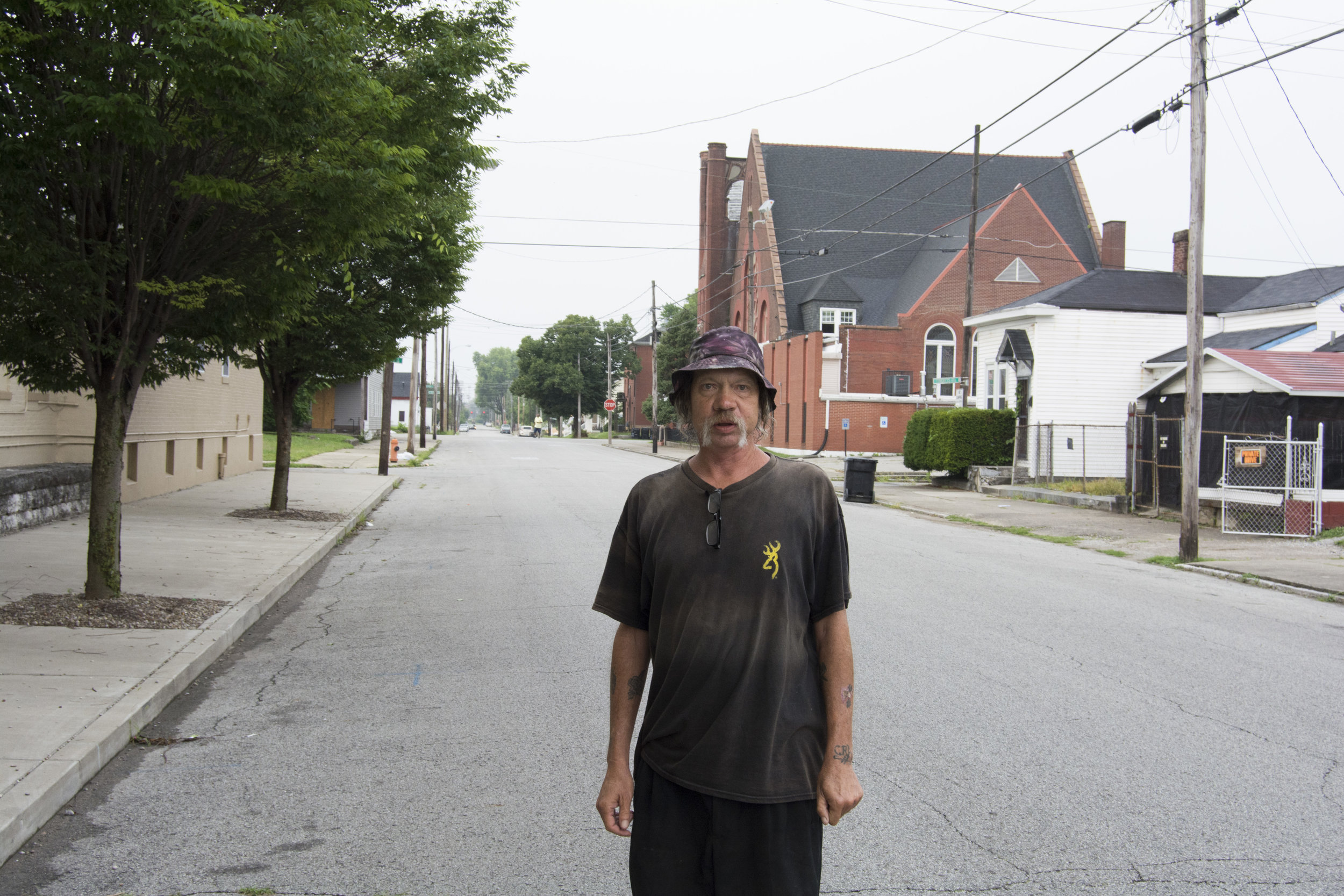"""I was married for 8 years. That's back when I was in Evansville, IN. That's where I'm originally from. I came here to go to JDAC to get cleaned out. I just decided to stay. I ain't gonna lie, I like Louisville. I had a little trouble. I've been jumped by some guys. That's why I carry that cane. I don't need that cane, I carry it for protection. They put eight stitches on top of my head, blacked my eye, didn't break nose, but bloodied it. Bruised my ribs. I just came from Labor Express, but I didn't make the cut. I just got those stitches out of my head about a week ago. They said it has to be completely healed before they let me work. I'm lucky they didn't break my skull."" - Chris, Portland"