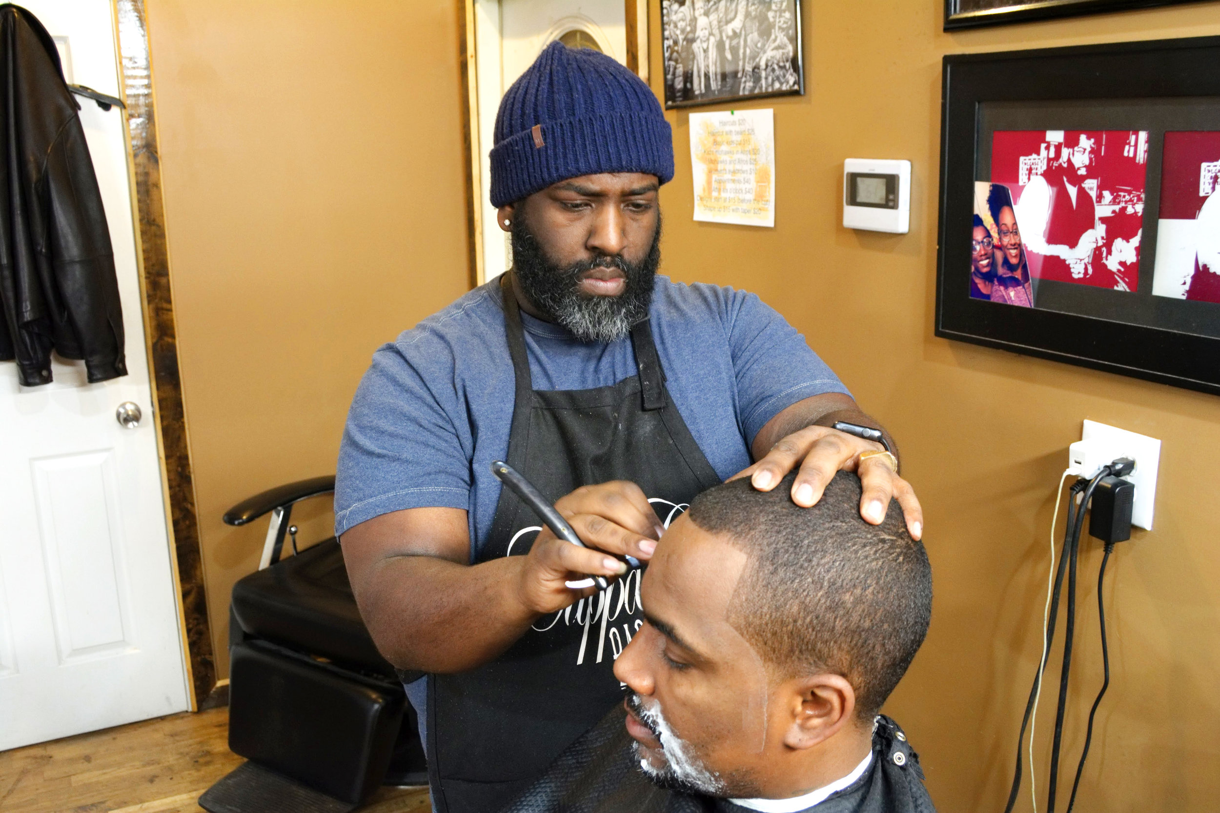 """""""My defining moment in wanting to become a barber is when I was taking my daughter's mom to her house and we rode past a barber shop. It belonged to this well known barber named Big Don. He was working at the time and it was sold out. He had the nicest car in the parking lot. That steered me into thinking that I could make a living with this. So many people miss out on their gifts. I had a gift, dealing with these clippers about 23 years ago.  Riding past Haskin's, right across Victory Park did it for me. I think that was the moment I knew that I needed to be in the barber shop. My first week in the shop, I knew I was going to make it. The second week was kinda rough. The first week, I came in at the right time. I started on a Thursday, it was busy. It was a bunch of walk-ins and the shop was on Broadway. That started it for me and let me know that I'm gonna be alright at this.  What motivates me is watching younger barbers, that used to be customers, turning into the talked about barber. I've had the pleasure to witness that a couple of times. You know, guys that I've seen go to barber school and now they're the household name. That motivates me.  I remember walking in here and no one could see my vision. The barber that moved in here with me couldn't see it either. He was like, 'Man, we ain't gonna make no money, right here!'. You can make money anywhere, it's you. It's not the location, it's you. Now, location plays a part on the traffic but once you get a good barber, you don't want to have to keep traveling around, trying to find somebody else.  My service to the community has been positive. There's been a lot of guys that have come to me for advice. I've even came in here needing advice. I've cut a lot of prominent people over the years. I ask questions. If I don't know something, I'm asking questions and a lot of people have helped me. One of the most humbling experiences that I've had is when we moved over here. All I had was money to buy the building but no"""