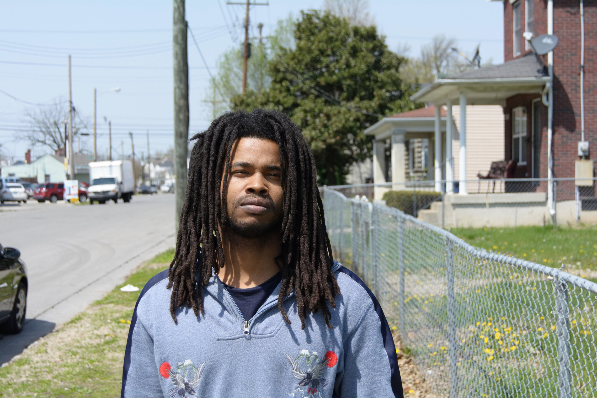 """""""I'm from East Louisville and I've been in the West since 2008. I'm originally from Clarksdale Projects. You see, they tore my neighborhood down. Yeah, so I'm from the East End. I've been in the West for about ten years, now. It's a beautiful part of town. It's bigger. It's alright. I come from the projects, so I was used to the project life, with the apartments and everybody's in one space. It's a bigger part of town, down here.  They need to put more stuff out here for the kids. They're taking all the community centers and tearing everything down. In the neighborhoods, where it's majority black, there's no positive activities for the kids. Yeah, they got churches but everybody's not into religion. You can't force that on nobody. There ain't no skating rink, movie theater, no nice little centers with game rooms and stuff. Even if it's a computer room, where the kids can just go in there and get on a computer or an iPad. They need stuff like that.  The struggle inspires me because I really want more. I want more for myself and my community. I know what would help if the opportunity was given to a whole lot of us. A whole lot of us ain't got nothing to do but to get get into the streets. The struggle inspires me and just seeing young black men turn their life around and doing something positive. When I see other people grow, it inspires me and makes me wanna grow. It makes me wanna put out that energy to make someone else grow.  I'm putting my energy to making myself better. I got a book called, 'Hustling is a Habit', it's on Amazon. I'm also about to drop this new music, on Tuesday, on all social media outlets. It's called 'A Mouth Full'. I gotta couple properties, I'm into real estate. I'm trying to build a solid foundation and leave a nice little legacy.The way society is set up, it's best to invest in yourself and be an entrepreneur. It's so many opportunities and it make things happen for yourself.  Believe in yourself. Everybody's a genius, you just have to tap"""