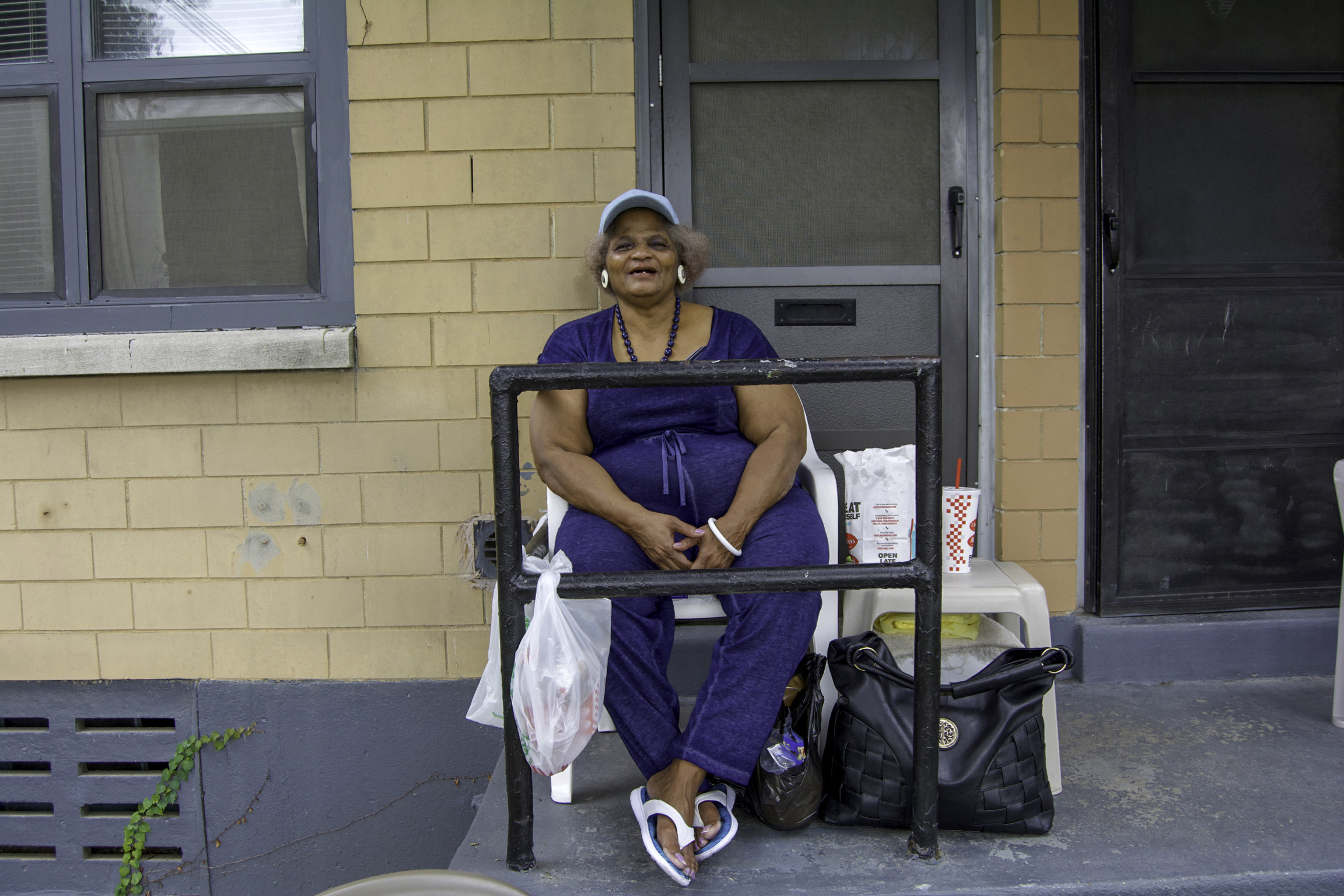 """""""I've been in Park Hill for almost twenty-six years. It'll be twenty-six years in October. So, I've been here for a while. I'm kind of ill, so I just hang out around here. I love going to church but I haven't been able to attend lately. Now, I just listen to it on my radio but when I start feeling better, I'll make it back in there. I have arthritis in my legs and it's been going on for some years. It keeps me from doing a lot of moving.  With all of this going on, I've started to enjoy reading. I've learned how to read better. It makes me really want to go back to school. It's never too late, you know. Things were just going on, in my life, that kept me from going back to school. I feel like I can really do it and see myself reach my goals."""" - Carolyn, Park Hill"""