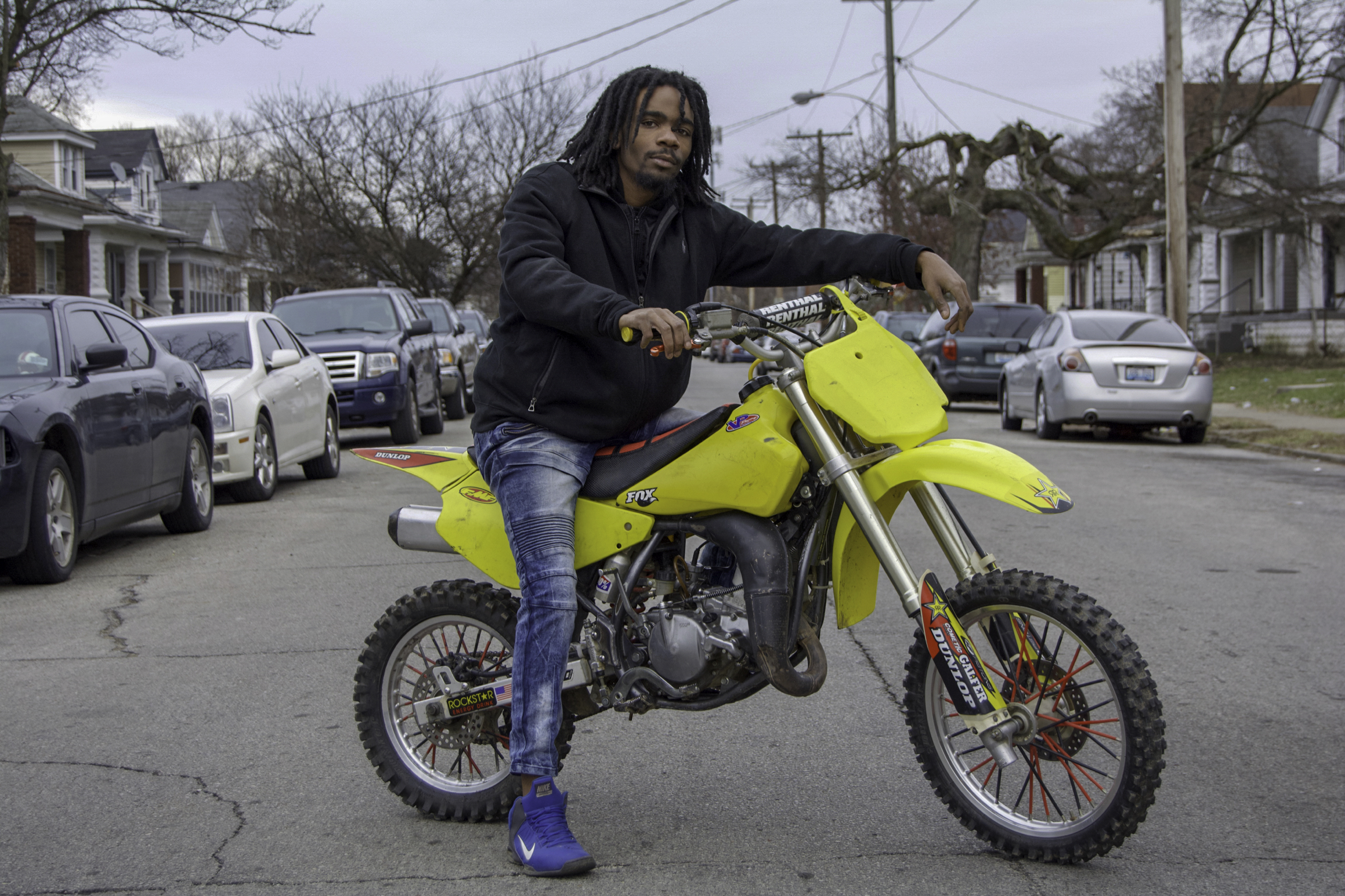"""""""I'm just trying to promote bikes. If you get on one of these things, it's hard to get off. You ain't finna get in no trouble. I'm not looking for no BS. Basically, I just want to see more people in my neighborhood rides dirt bikes and hopefully, get us a trail over here, one day. I don't wanna keep riding on the streets and worrying about the police. Once you get on one of these, you're not getting off.  This is definitely my passion. It started when I was six years old, when my grandma got me one of those small dirt bikes. When I saw the older kids with their bigger dirt bikes, I always wanted one. The older I got, I would spend my money and buy a bigger bike. I just bought this bike. I just lost a bike, last year, and broke my leg. My leg was broken and I bought another bike and I rode with a broken leg. This is my passion. Regardless, I'm going to ride a bike.  I'm not doing nothing else. It's not like I'm out here, doing anything bad. The police look at us like we're doing something bad but I'm not bothering nobody. You got cars with mufflers and all extra types of exhaust modifiers and stuff. I don't come out late at night or very early in the morning; the afternoon is good for me. I don't bother nobody, man.  I want everyone, around me, to ride because it's boring doing it by yourself. I want to start my own garage and work on them. Once you get everybody on it, I'll get you running for free but after that, throw me a little something and I'll work on your bike. I want to get me a little garage. We don't have nothing down here that will fix this. I gotta work on this by myself. There's no where, around here, that I can take this bike to. There's not one professional place for it. I gotta do it myself.  Find you a passion. If you find a passion, you'll stay out of harm's way. If you find a passion, you're gonna wanna do it all the time; it's like an addiction. You're not worried about nothing else going on around you. When I'm flying through these streets, I'm"""