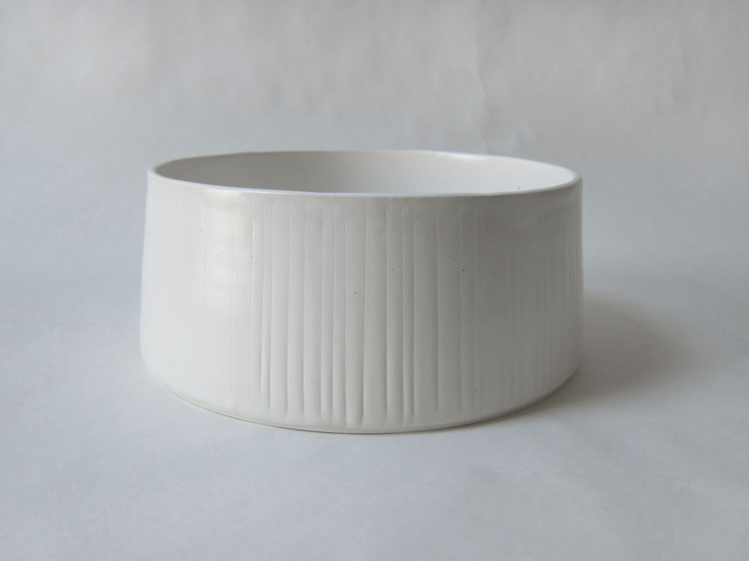 Large low dish with vertical lines