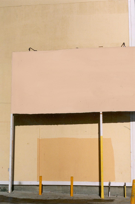 Erasure (peach billboard orange wall)