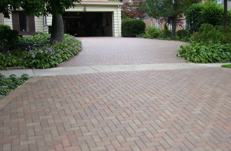 Brick driveways with sidewalk parkway inlay and framing