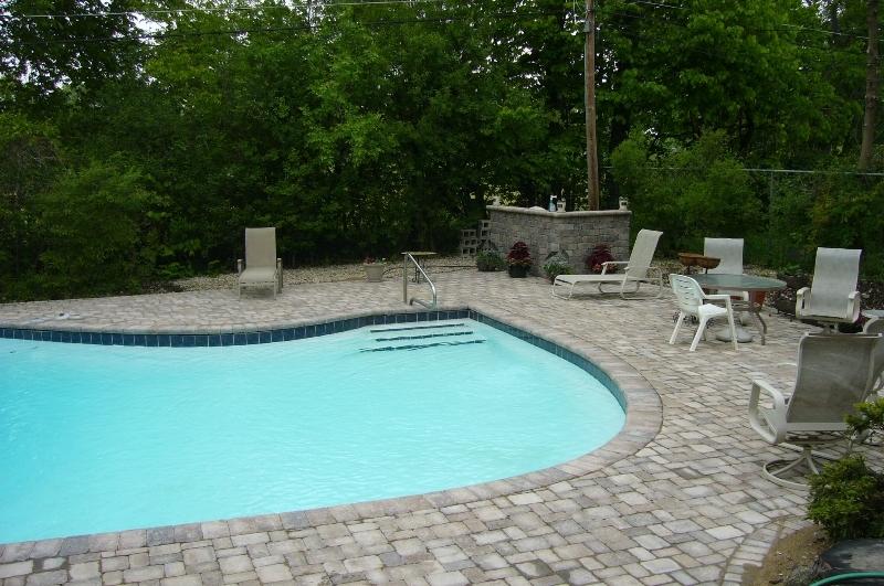 Pool decks brick work light tile used sloping away