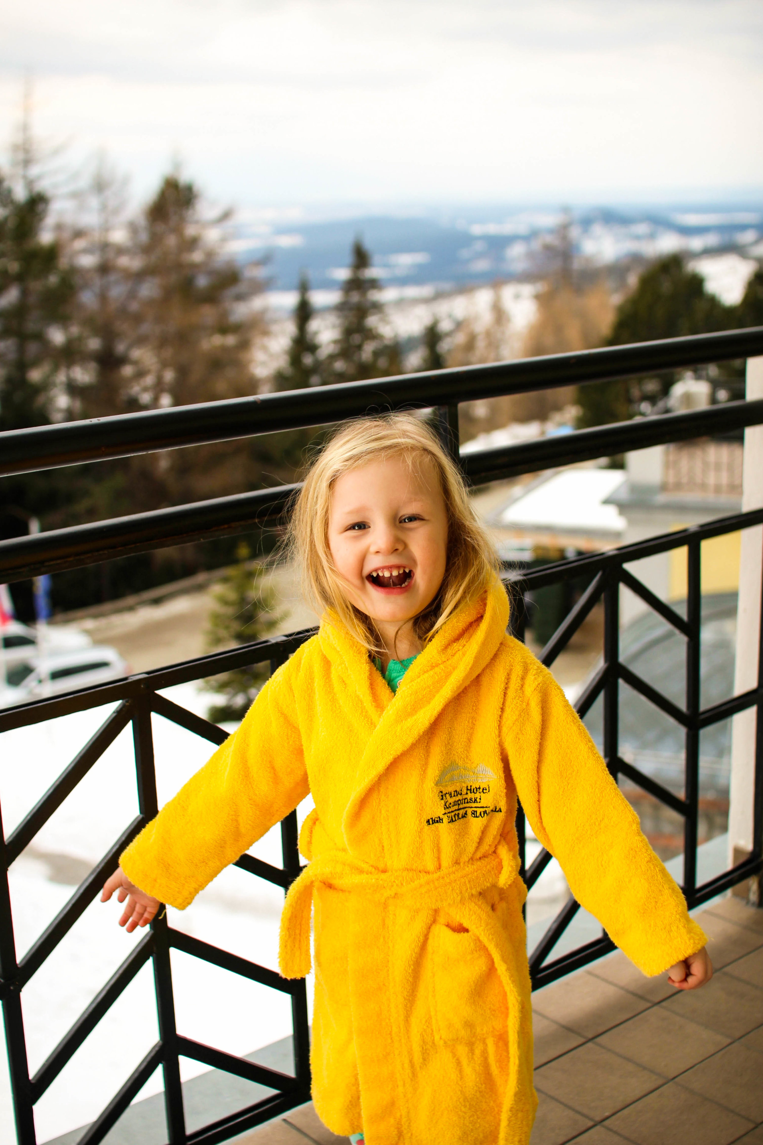 Smiles from a snowy Grand Hotel Kempinski High Tatras in Strbse Pleso, Slovakia