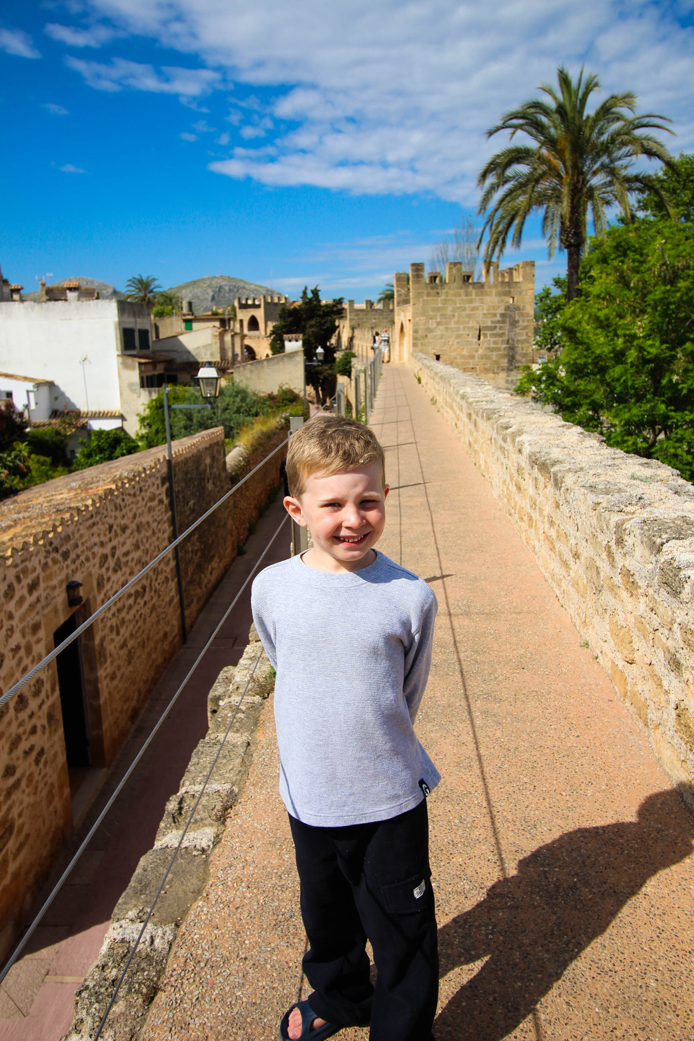 Exploring the ancient walls of Old Town Alcudia - a great non-beach day activity!