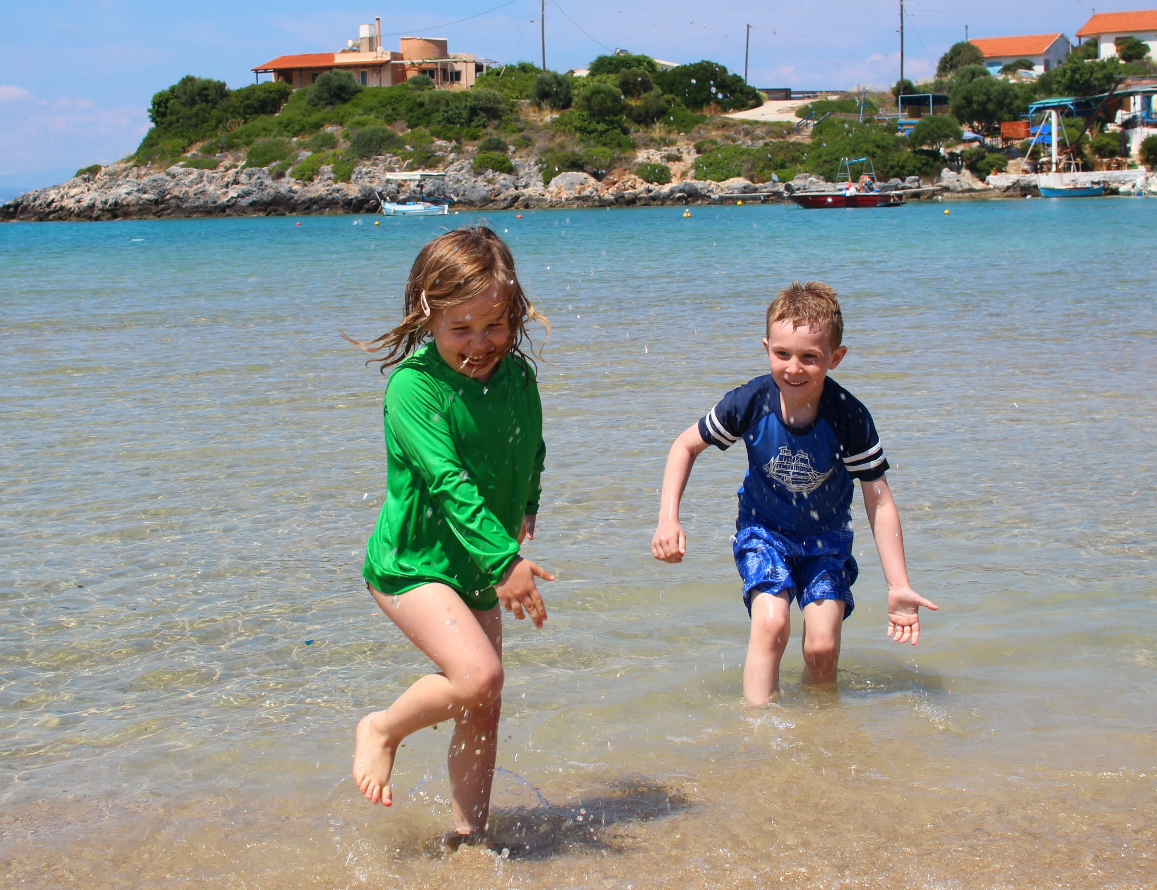 Water fights on Tersanas Beach, just 20m from Villa Kiara, our rental home