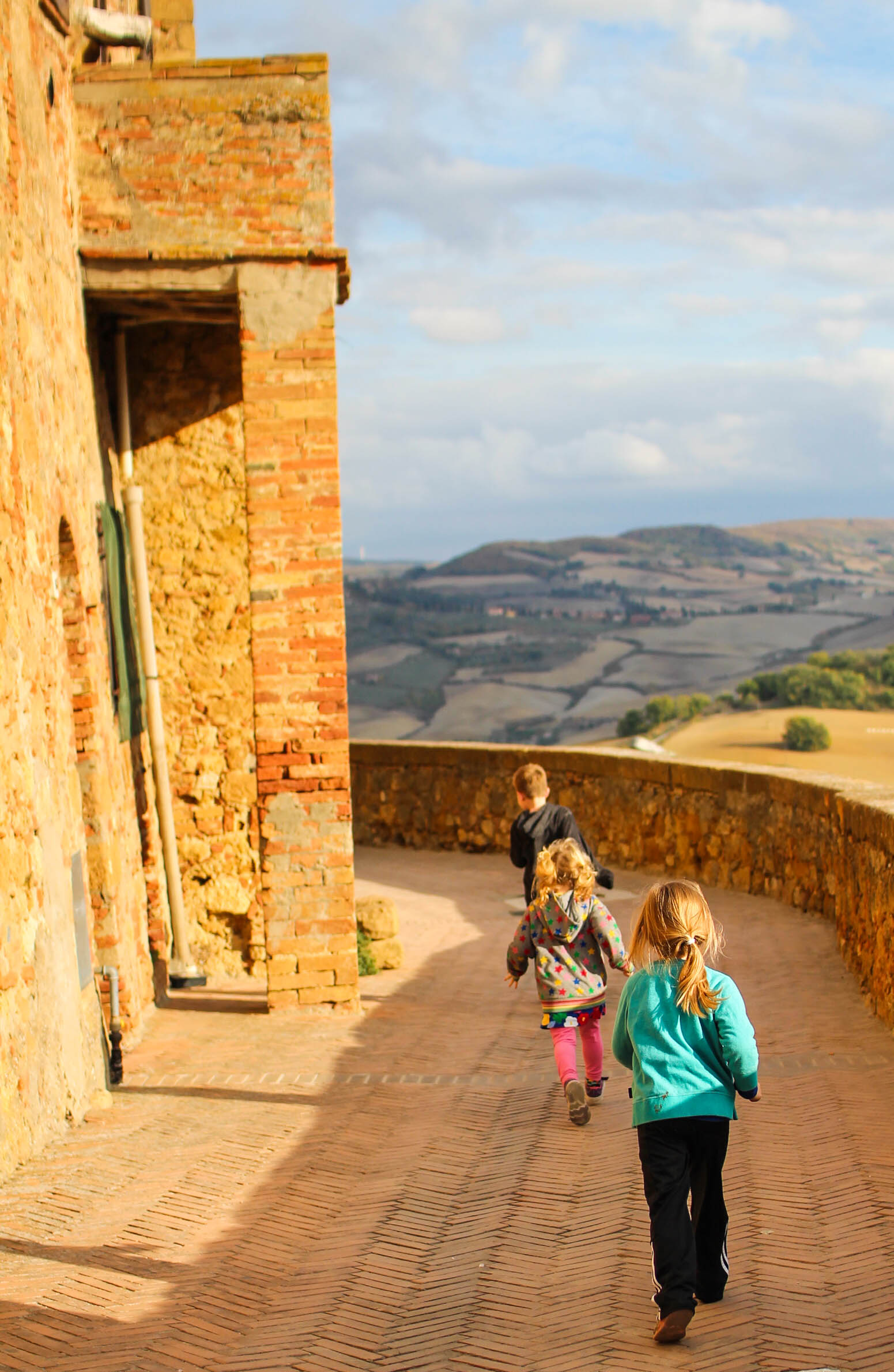 Running the old city walls of Pienza - so much fun!