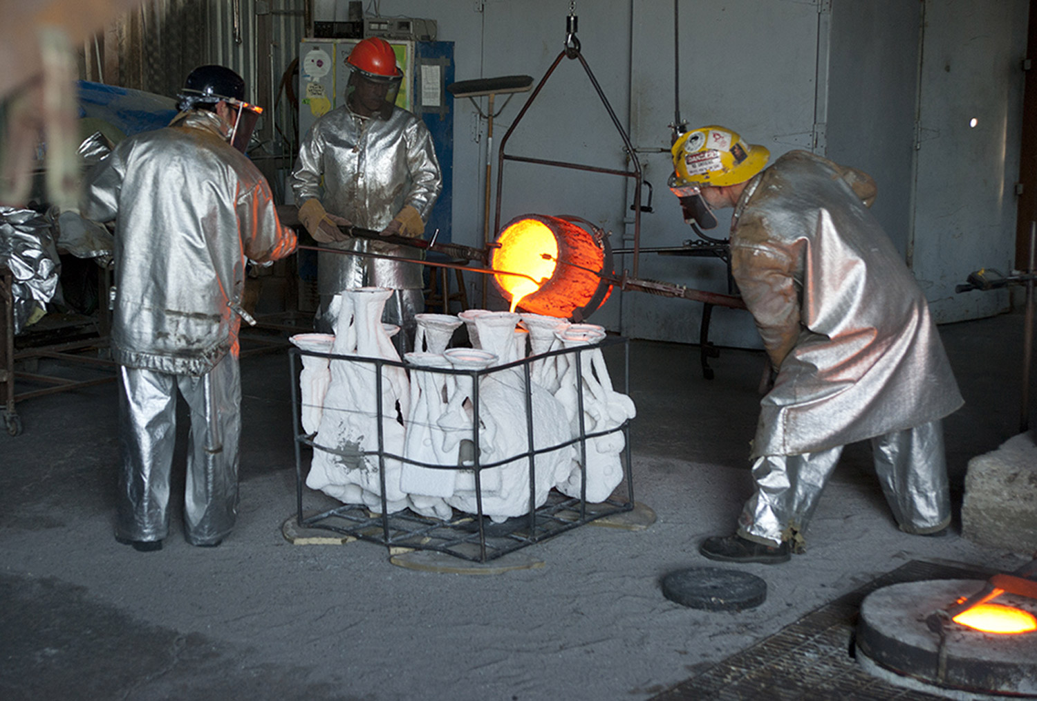 Molten bronze being poured into the a section of the full-sized Nikola Tesla statue ceramic shell.