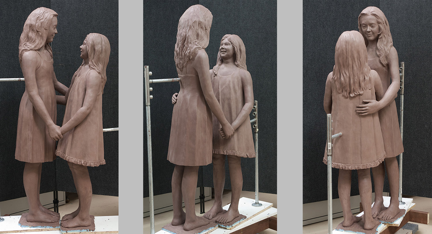 The clay artwork from 3 different angles.