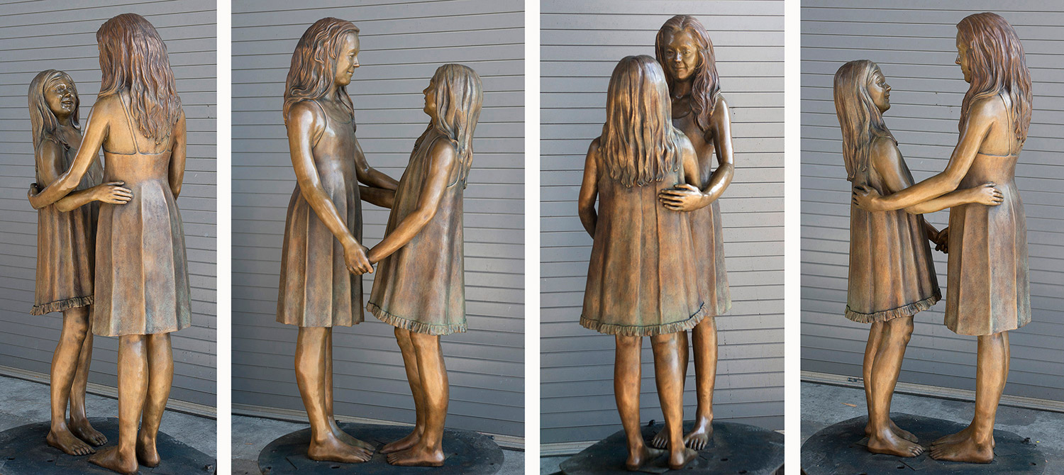 Four angles of  Two Sisters bronze after receiving the final patina.
