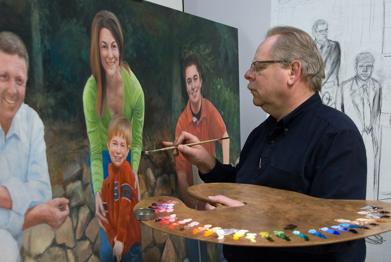 """Terry Guyer working on the Moquin Family Portrait 48x72"""" oil on linen."""