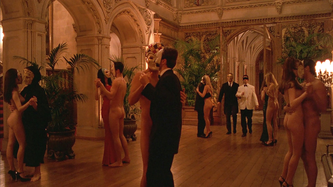 Mansion ballroom dance scene with Nick Nightingale (Todd Field) blindfolded, in  Eyes Wide Shut  (1999)