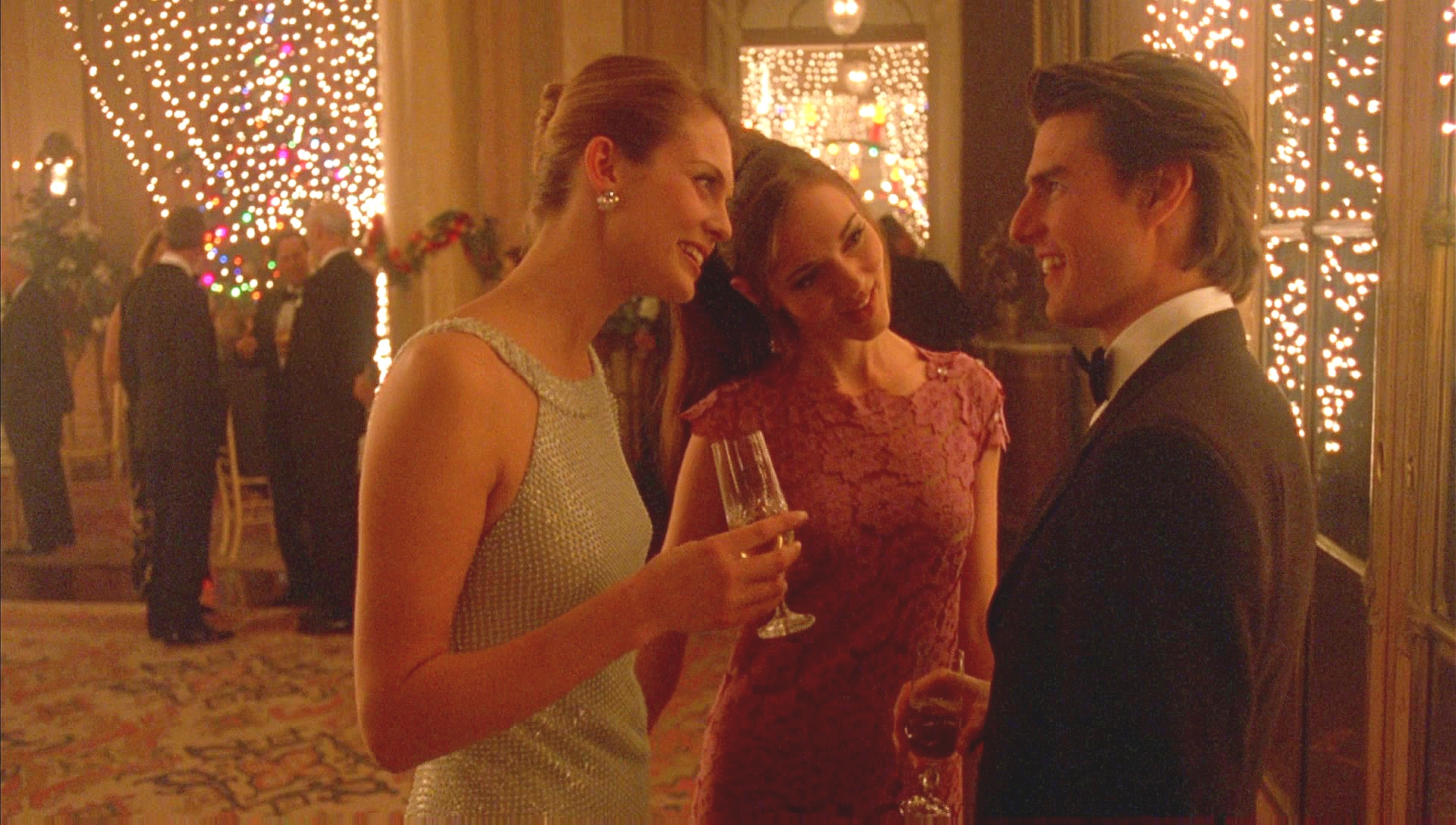 """Themes of doubling and twinship feature prominently in  Eyes Wide Shut , as in this scene where Bill Harford flirts with """"two models"""" (1999)"""