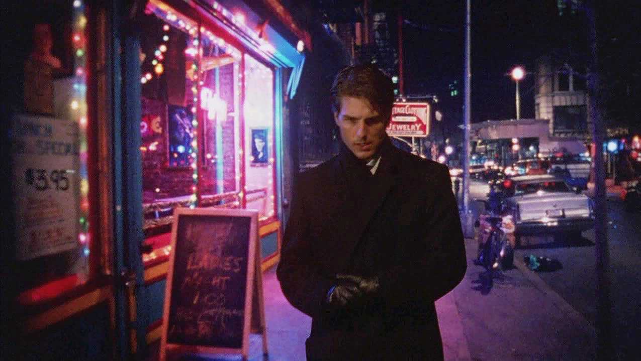 Tom Cruise appears in front of a rear-projected cityscape scene in this shot from  Eyes Wide Shut  (1999)