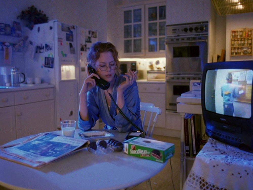 Kidman as Alice Harford in  Eyes Wide Shut  (1999); her television plays a movie about a cheating husband, while she talks on the phone to her husband who is attempting to cheat
