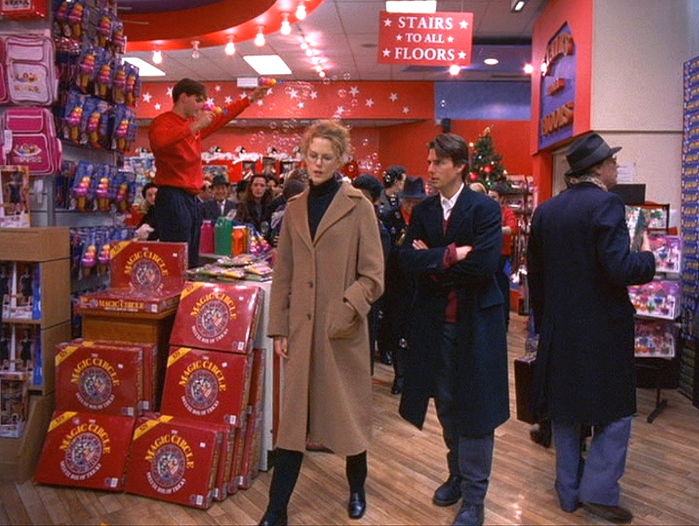 """Alice & Bill in the toyshop scene; objects in the store reflect things that appear earlier in  Eyes Wide Shut , like the """"Magic Circle"""" game (1999)"""