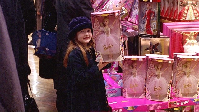 Helena holds up a fairy princess Barbie Doll, recalling the fairy wings she wears at the beginning of  Eyes Wide Shut  (1999)