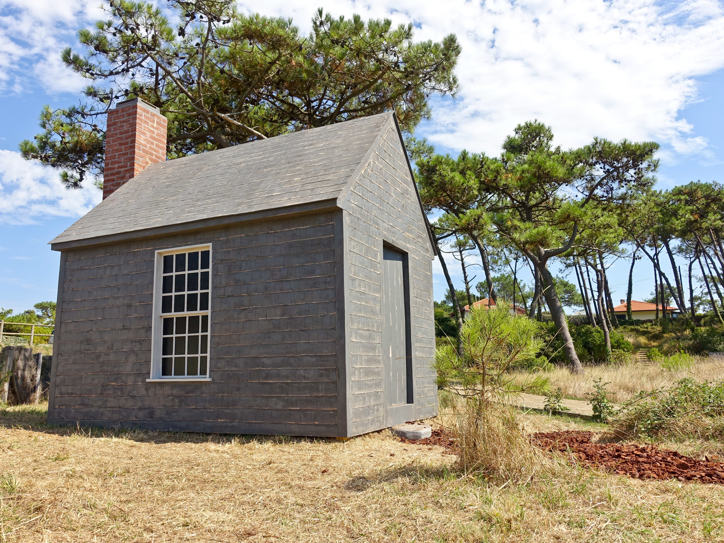 Untitled Project: Cabin [Thoreau]   La Littorale 6 Biennale Internationale D'Art Contemporain Anglet-Côte Basque Enamel paint, oil paint on carved wood, 1:1 scale 2016   A carved and painted replica of Henry David Thoreau's cabin at Walden Pond near Concord, Massachusetts. This cabin-as-object is intended to function as a sincere/unsatisfactory object providing a critical commentary on the theatre of nature and the commodification of self-reliance––all of which is useful for considering one's place in the natural world. This project was sited specifically on the shore of Lac Nord of Izadia Ecological Park in Anglet, France for La Littorale #6, Biennale Internationale D'Art Contemporain Anglet-Côte Basque curated by Paul Ardenne.