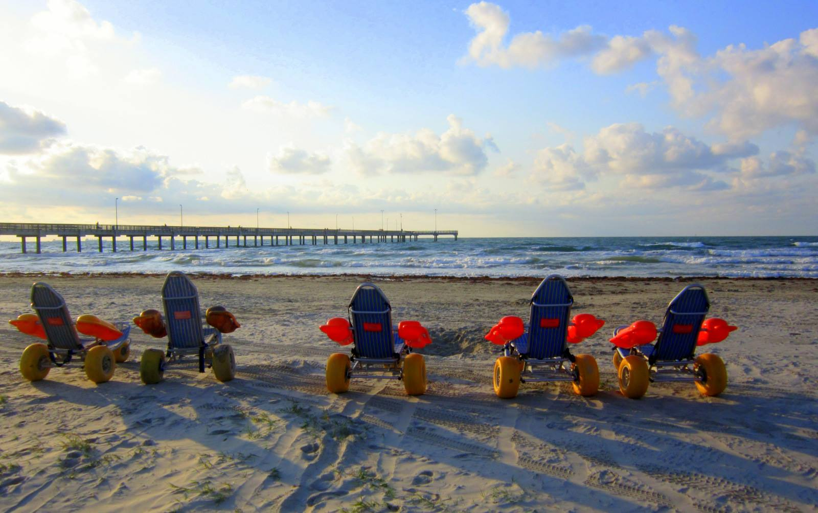 texas beach wheelchairs parked in a row gayla kolle goff.jpg