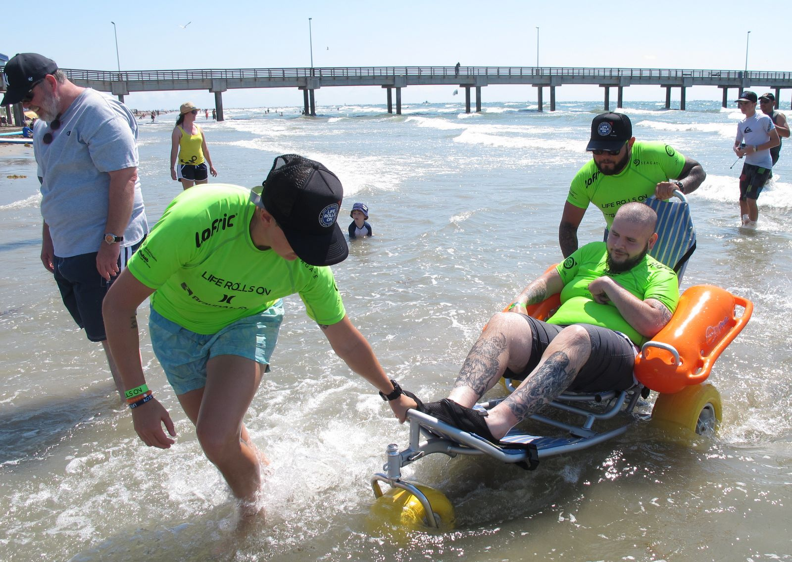 texas green team pulling chair out of water gayla kolle goff.jpg